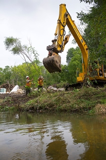 DNR crew works on a river bank