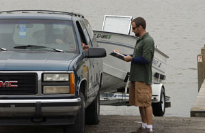 DNR creel clerk interviewing angler in truck