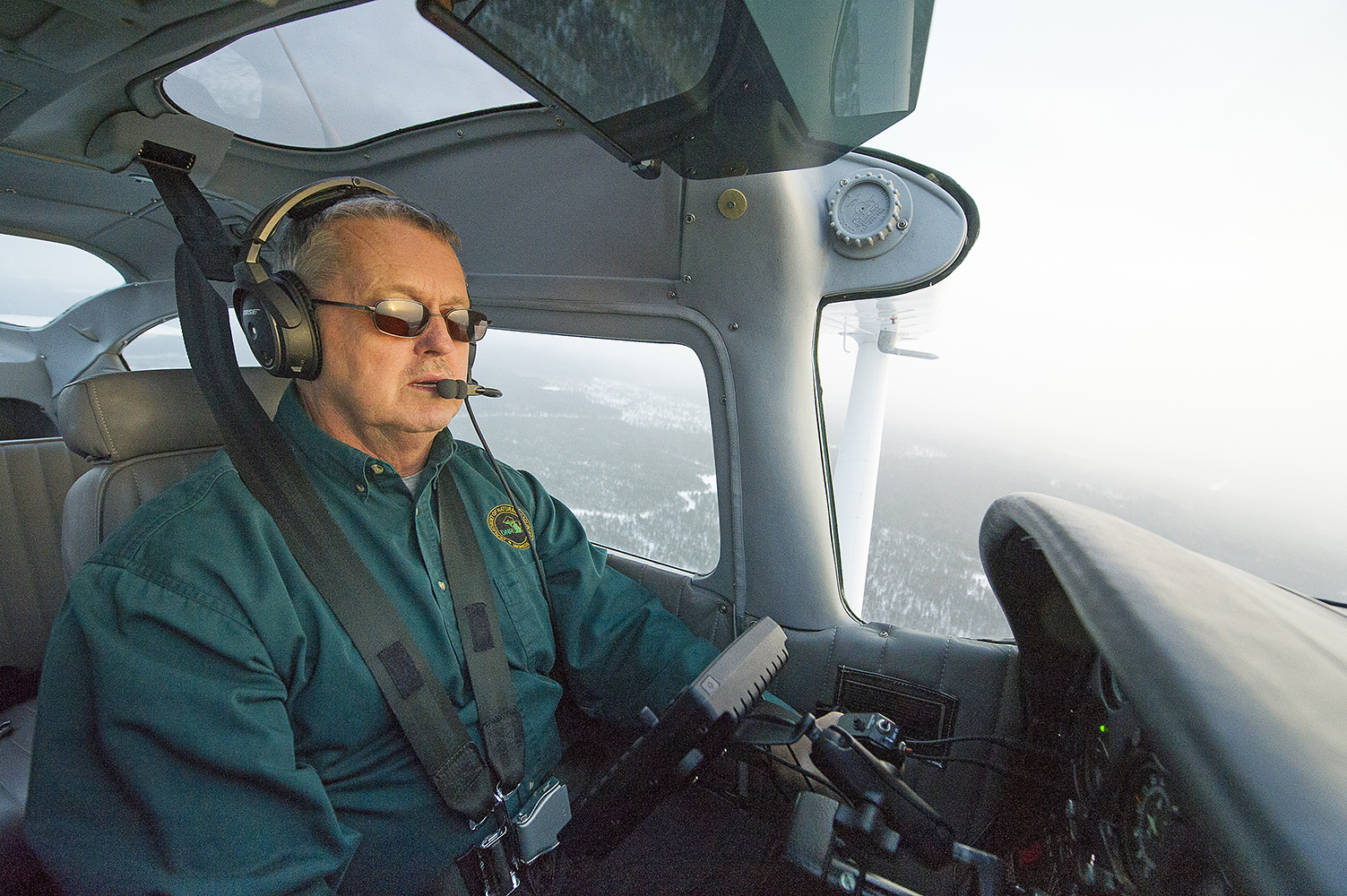Sitting in his cockpit is Bill Green, chief pilot for the Michigan Department of Natural Resources.
