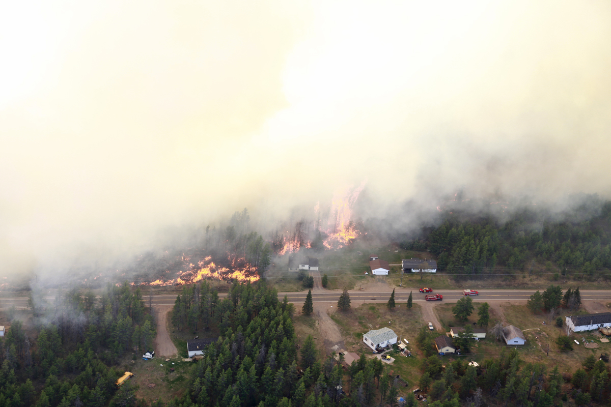 An aerial view shows the Black River Falls Fire races toward homes along Marquette County Road 581.