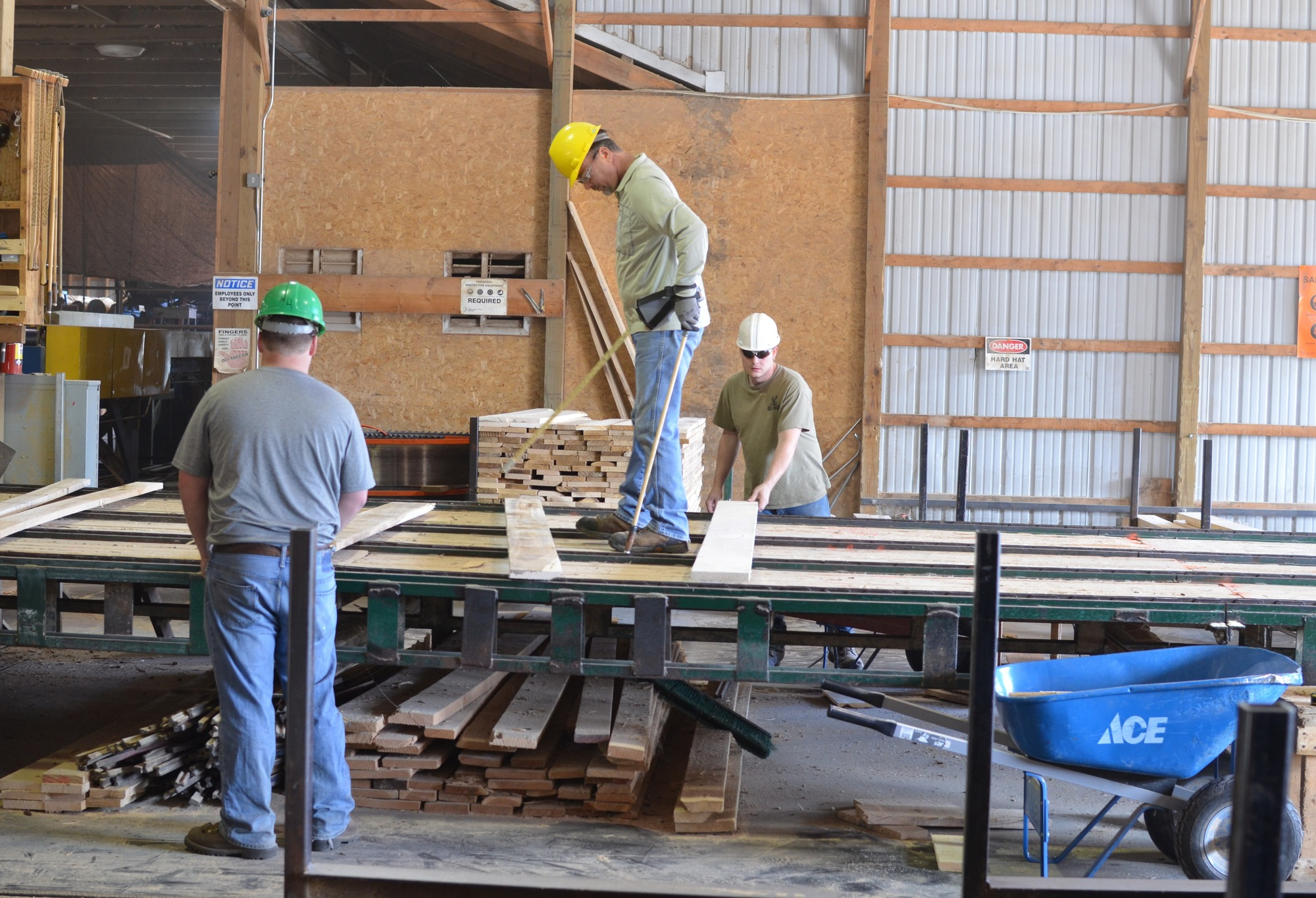 Workers moving wood through the milling process.