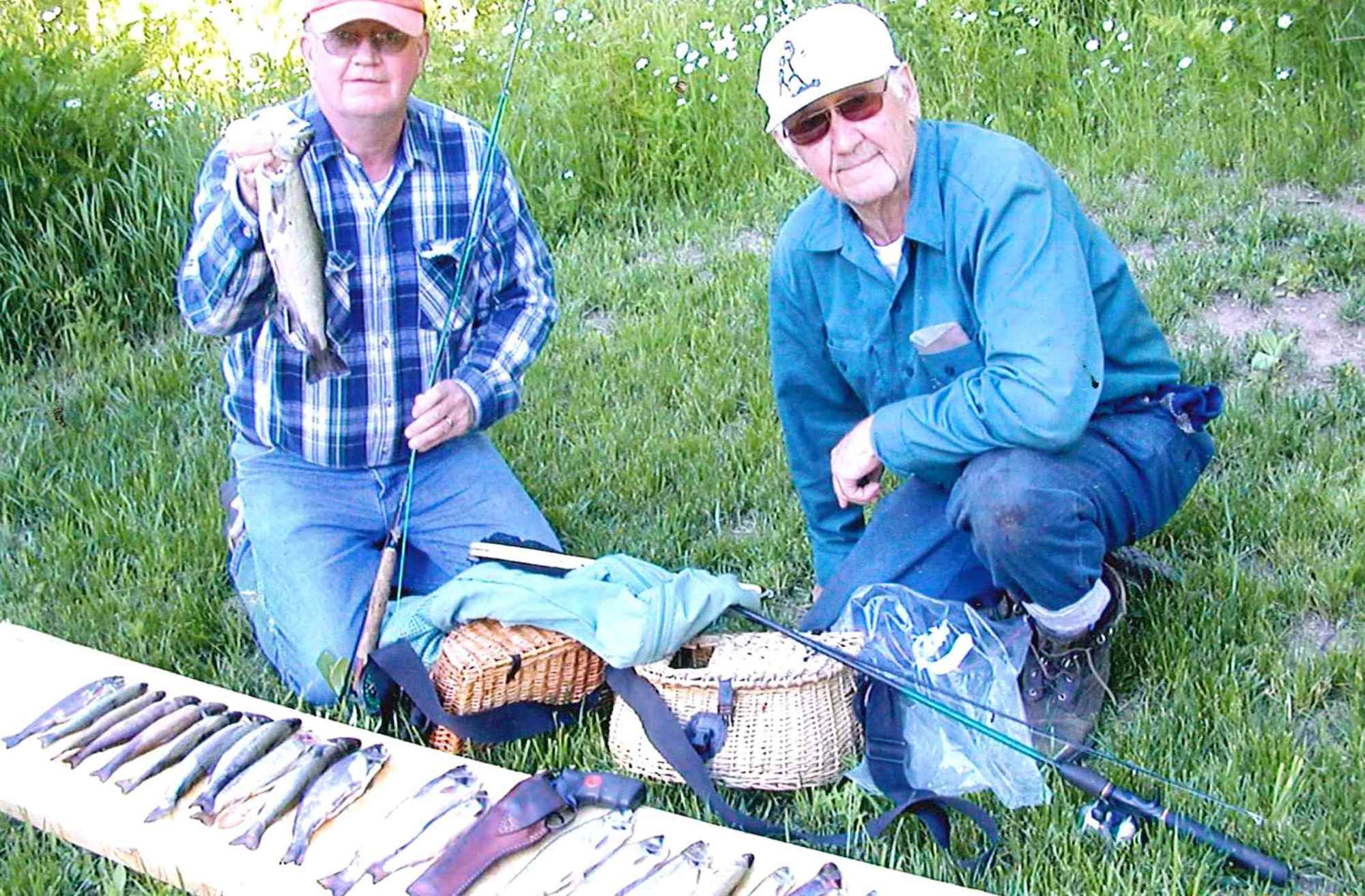 George Swanson, right, with his nephew, Bill Garrett, and a great catch of brook trout during a fishing trip in 2006.