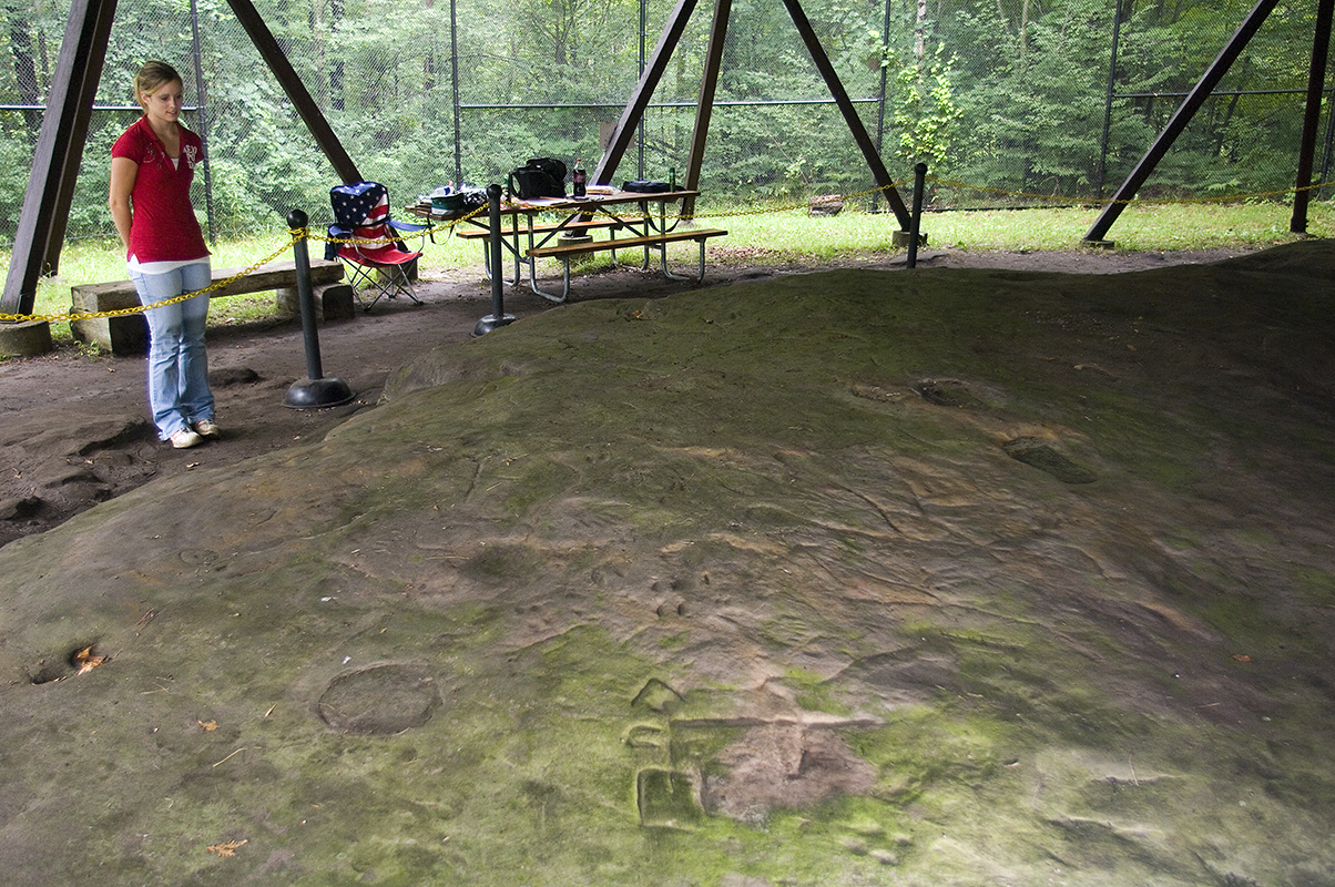 A visitor views petroglyphs at Sanilac Petroglyphs Historic State Park in the Lower Peninsula.