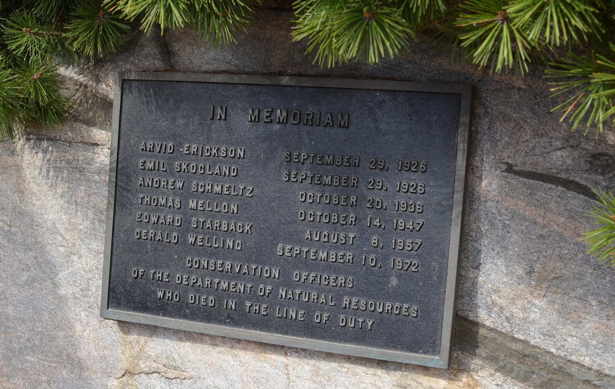 A memorial plaque outside the Michigan DNR Customer Service Center in Marquette remembers six fallen conservation officers.