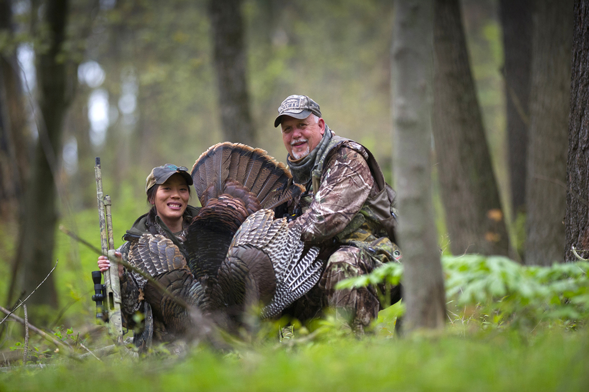 Learn to Hunt event organizer Johanna Dart with her first turkey, called in by Steve Sharp at the Barry State Game Area in Barry County.