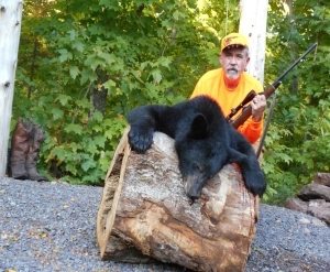 Dr. Phillip Berry with bear he harvested