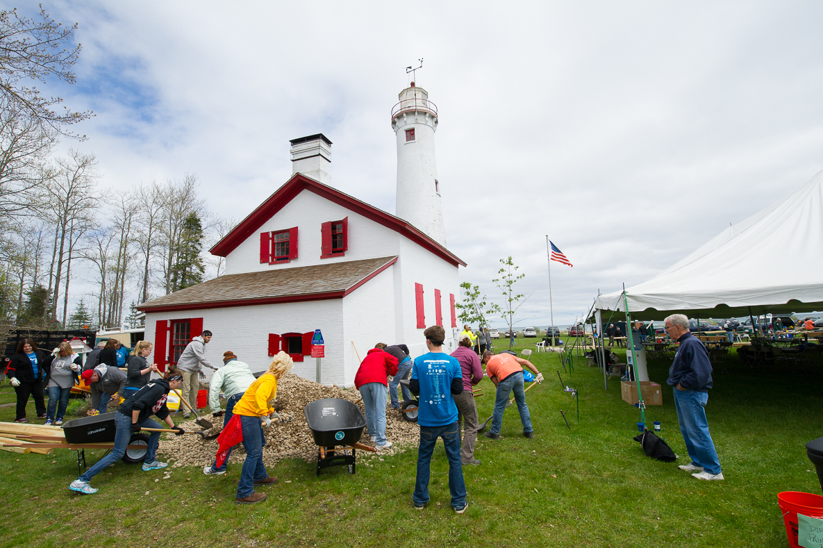 Workers in progress on a Recreation Passport grant-funded repair project at the Sturgeon Point Lighthouse in Alcona County.