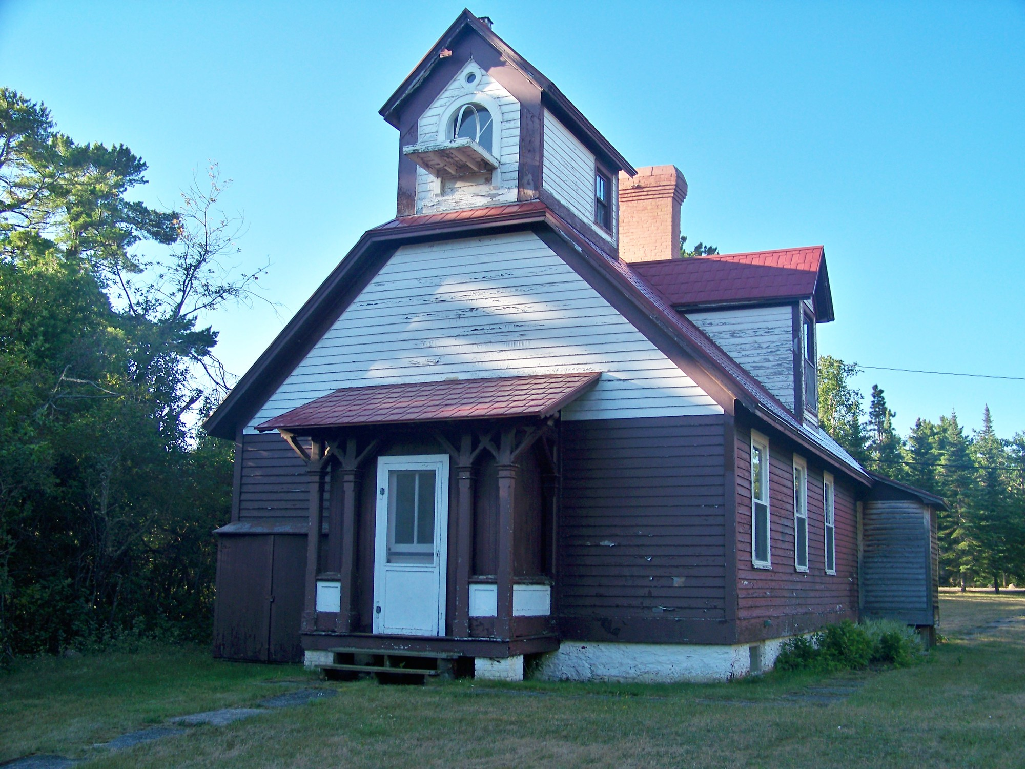 The 1868 Copper Harbor Range Lighthouse is shown prior to the start of restoration efforts, which are ongoing.