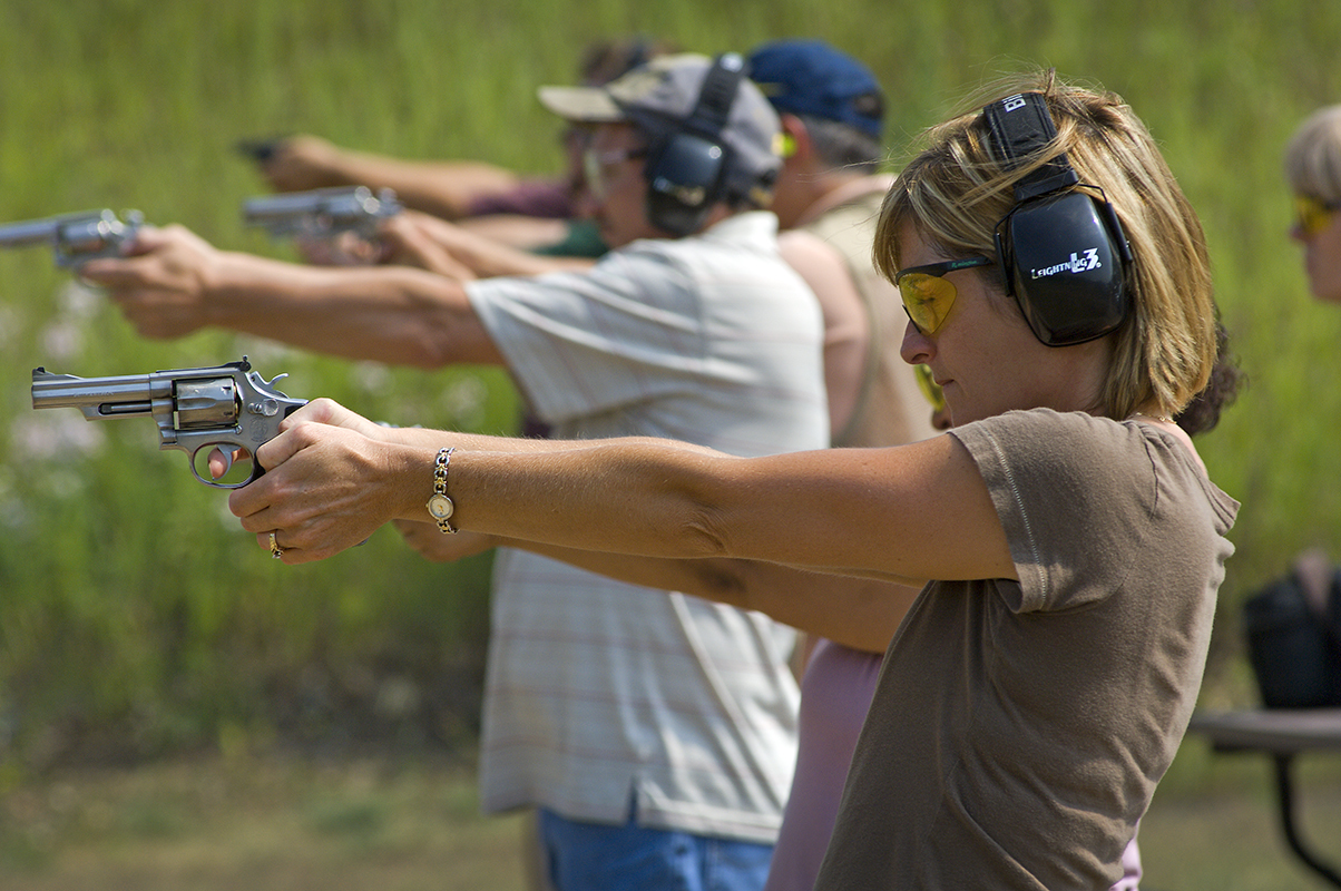 Julee Hasbany takes aim on a pistol range at the Michigan Department of Natural Resources' Rose Lake shooting range in Clinton County.