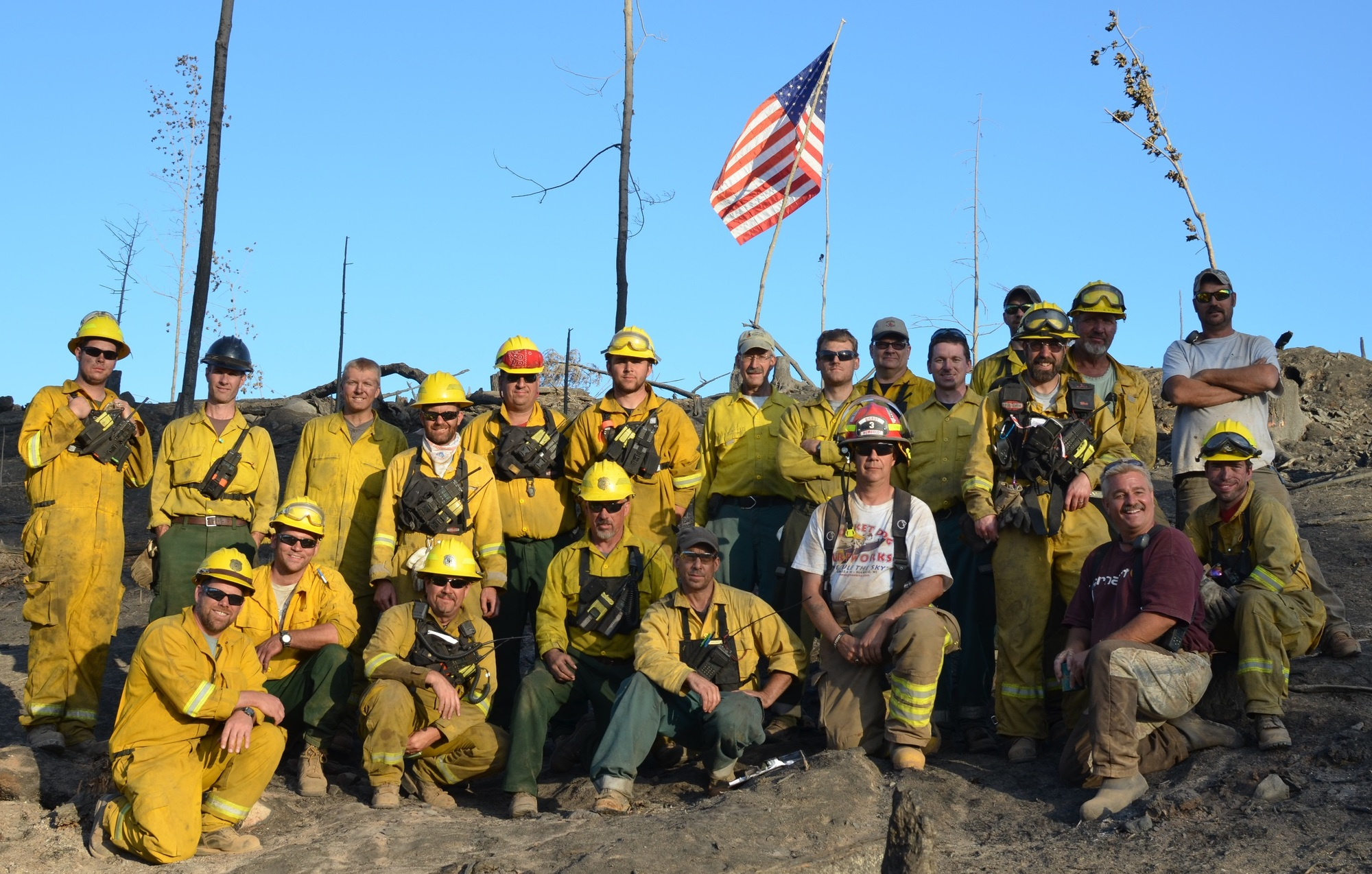 Firefighters assemble for a group photograph, having bested the 80-acre County Road 601 Fire in Marquette County in summer 2015.