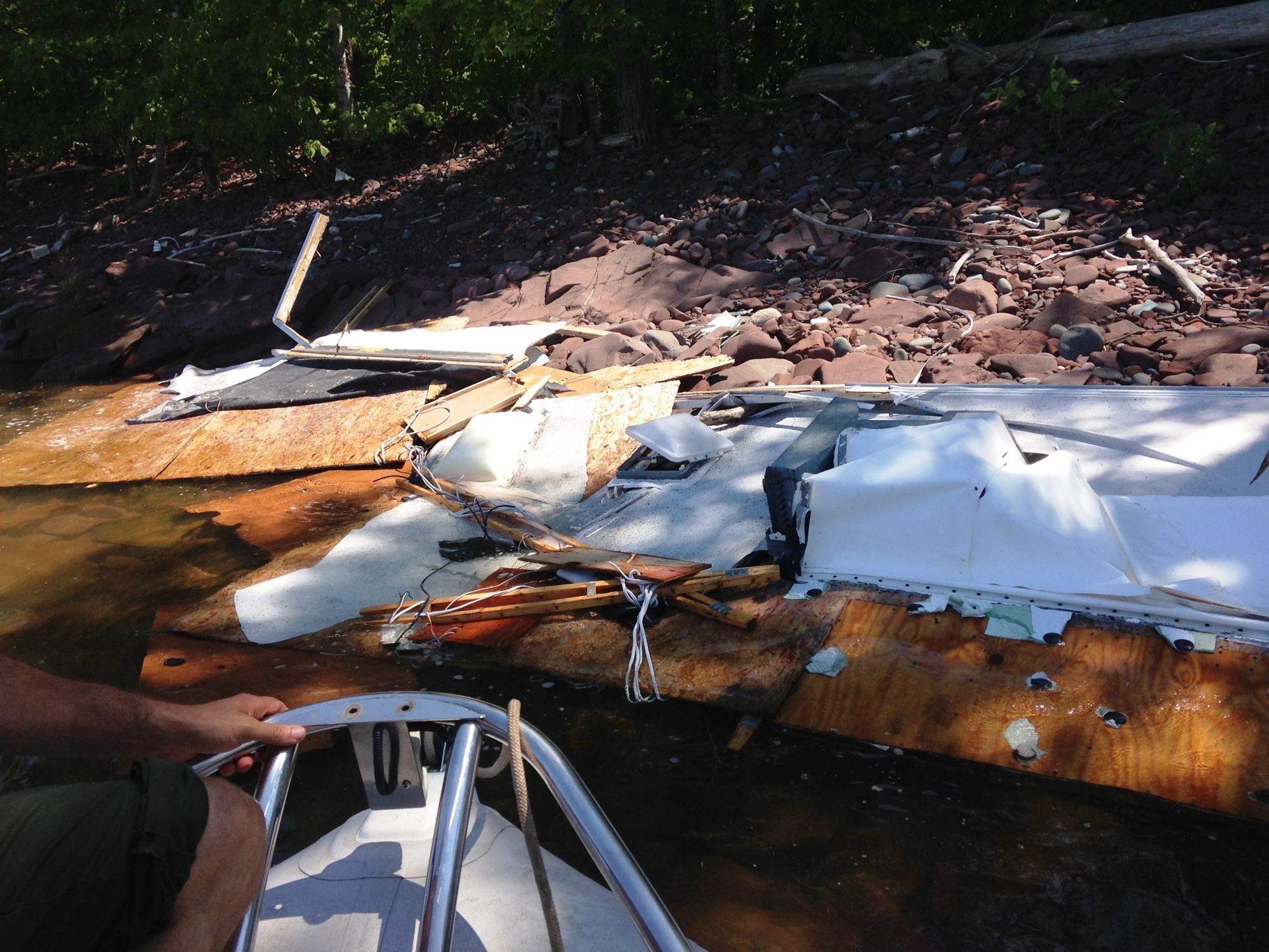A trailer washed up on the shoreline of Porcupine Mountains Wilderness State Park, believed to be part of the recent storm damage at Saxon Harbor.