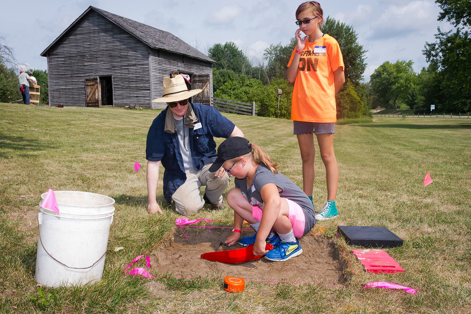 Participants take part in an archaeology program at Walker Tavern.