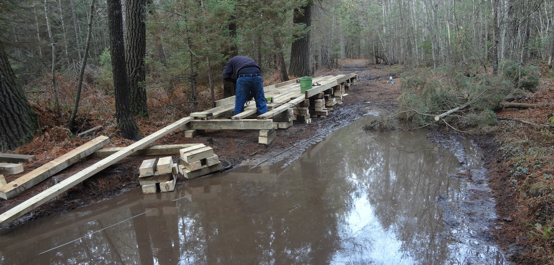 Work is taking place in this photo to construct a deck over a watery area in the Lower Peninsula.
