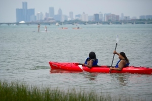 man and woman in kayak on Detroit River