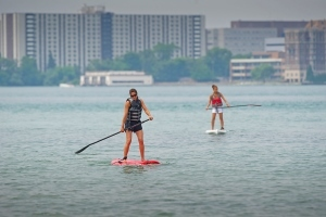 two ladies on stand-up paddleboards
