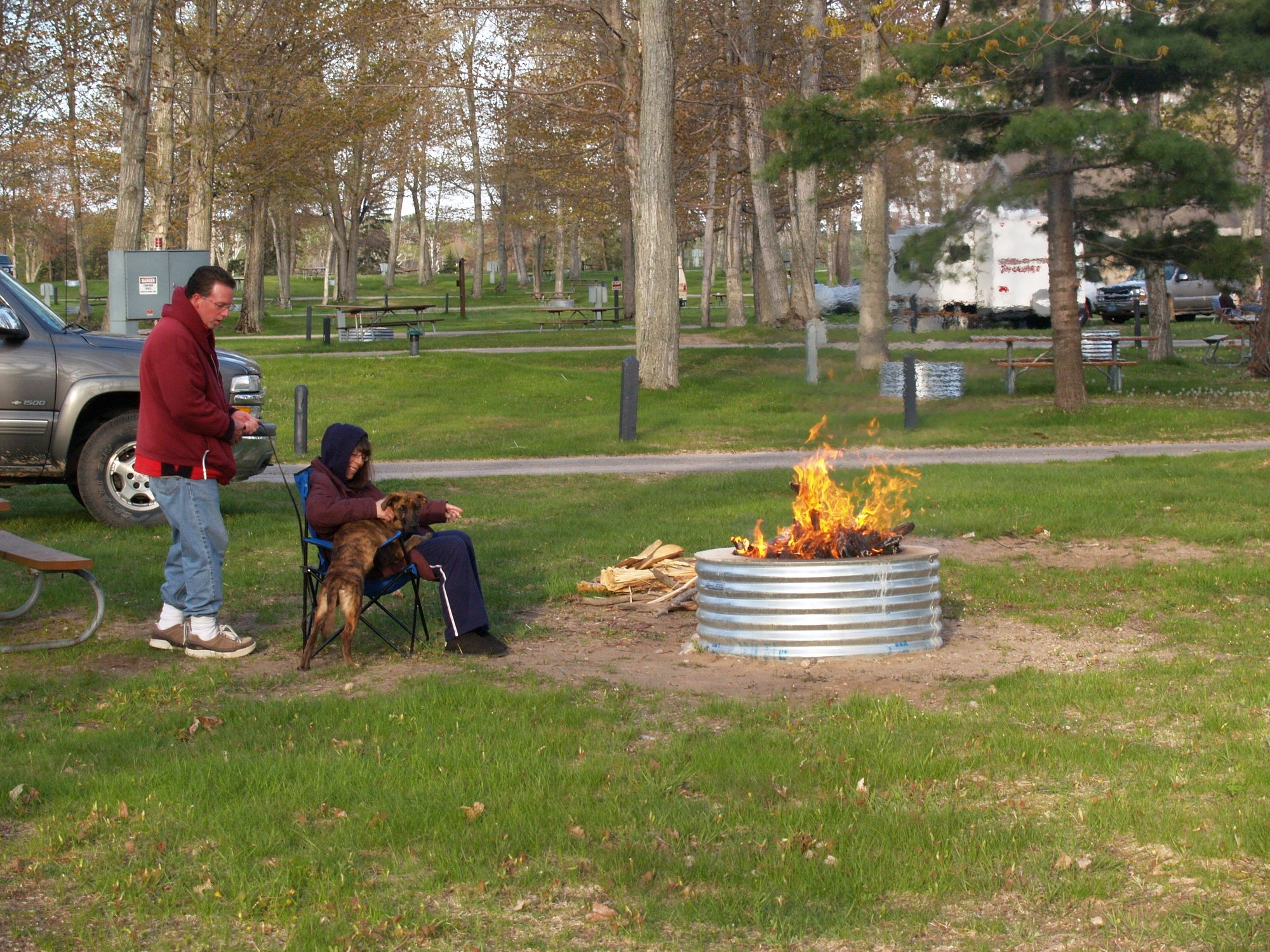 Campers enjoy a fire at Muskallonge Lake State Park in northern Luce County.