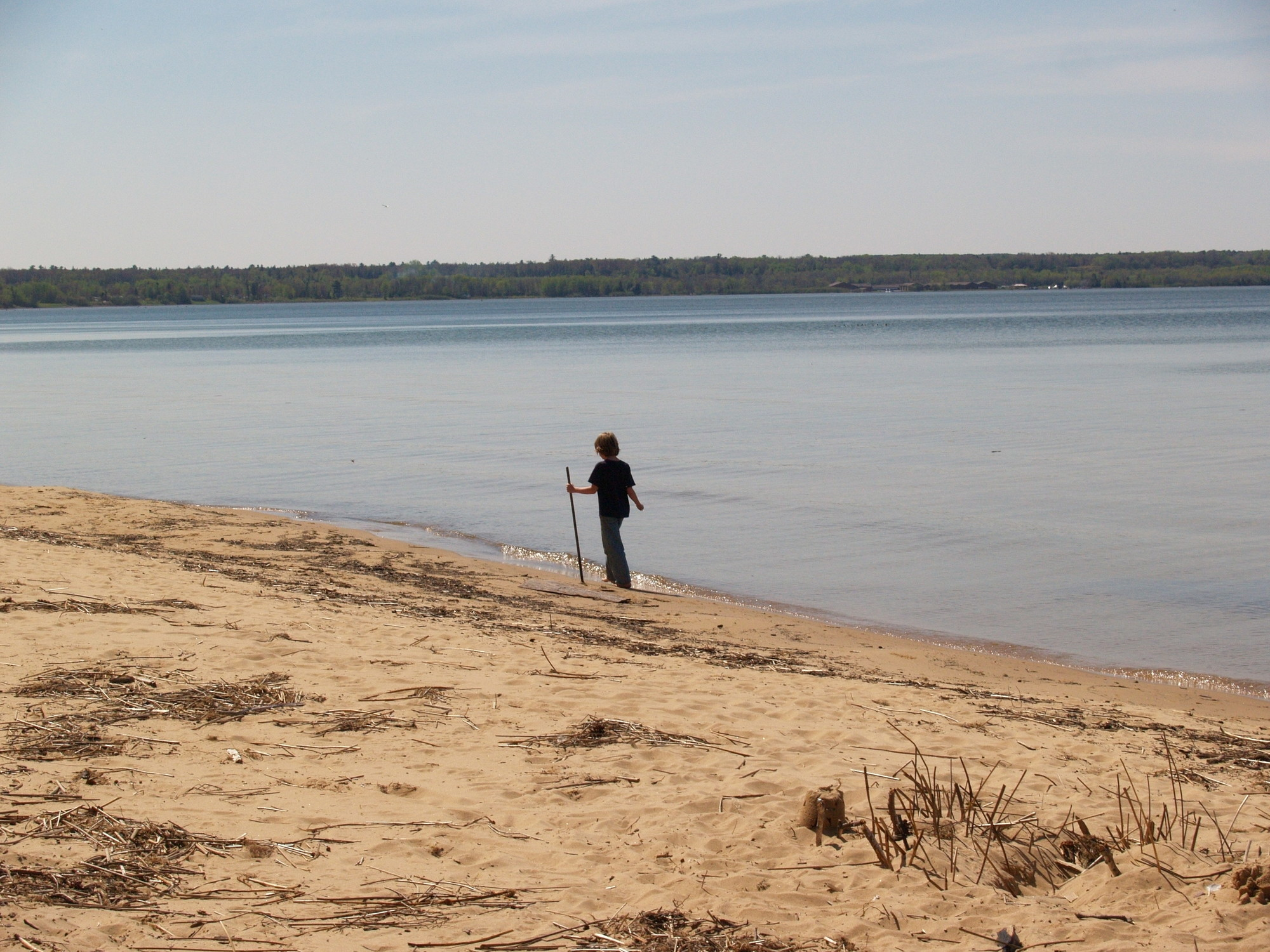 A visitor takes a walk along on quiet Lake Superior beach at Brimley State Park near Sault Ste. Marie in Chippewa County.