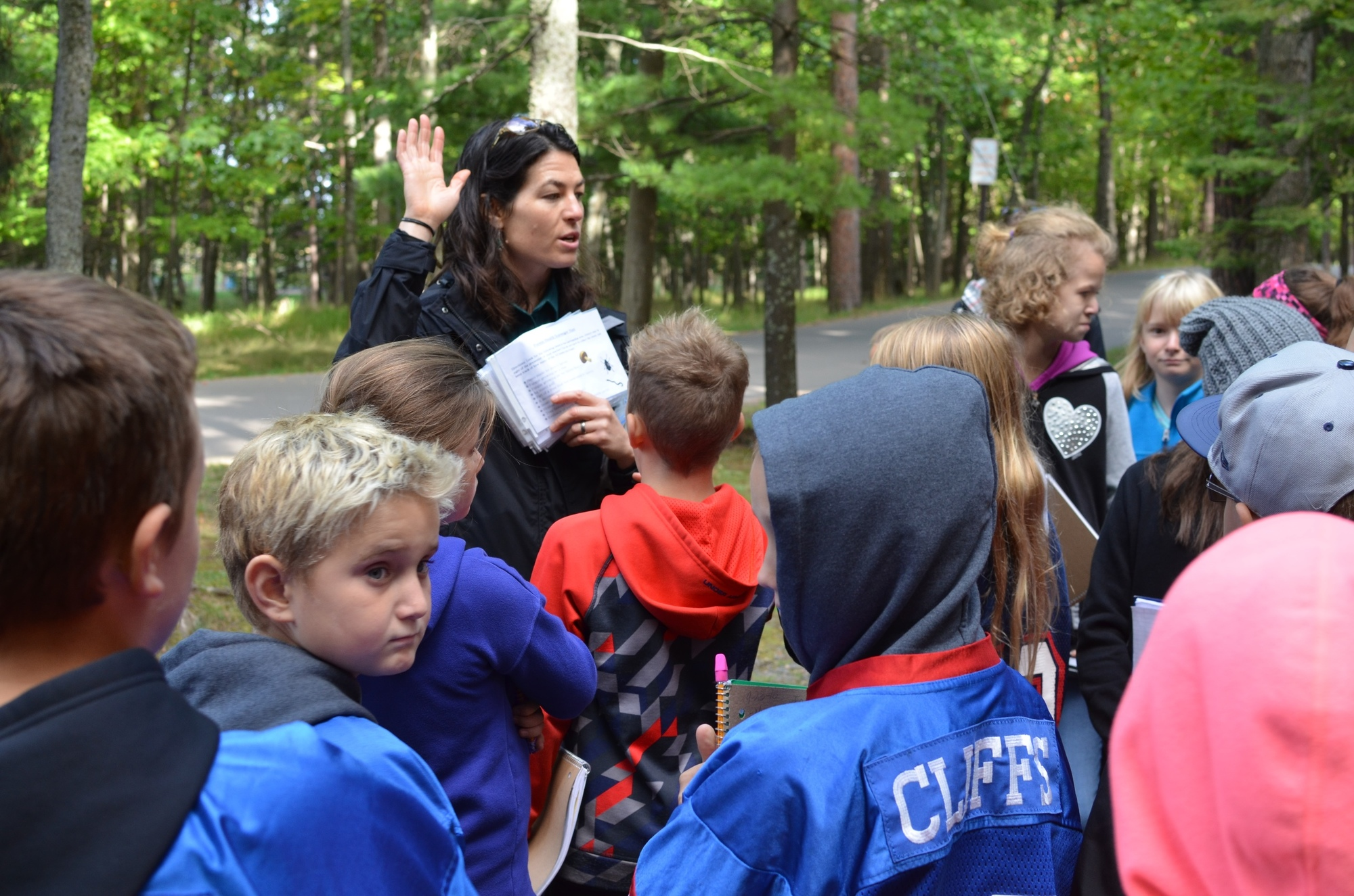 Rachel McDonald, a DNR forester from the Gwinn field office, discusses forest health students at Presque Isle Park during a forestry field day.