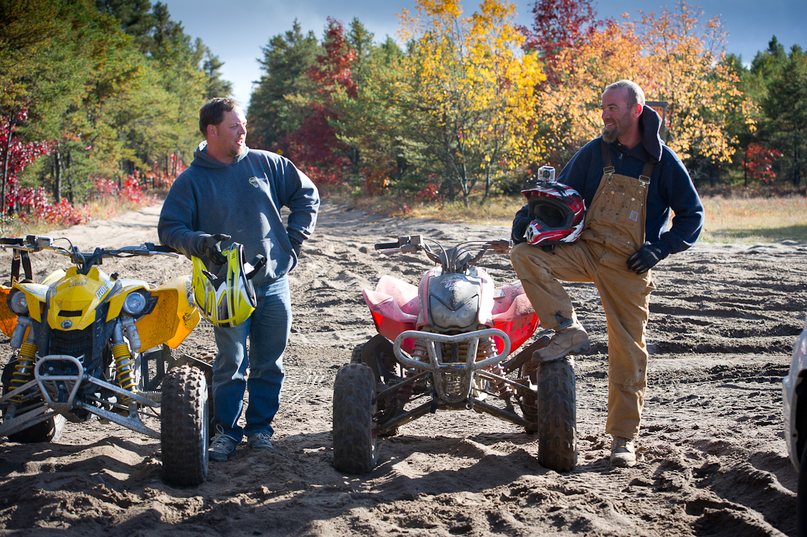 A couple of off-road vehicle riders stop along a fall trail near St. Helen, Michigan.