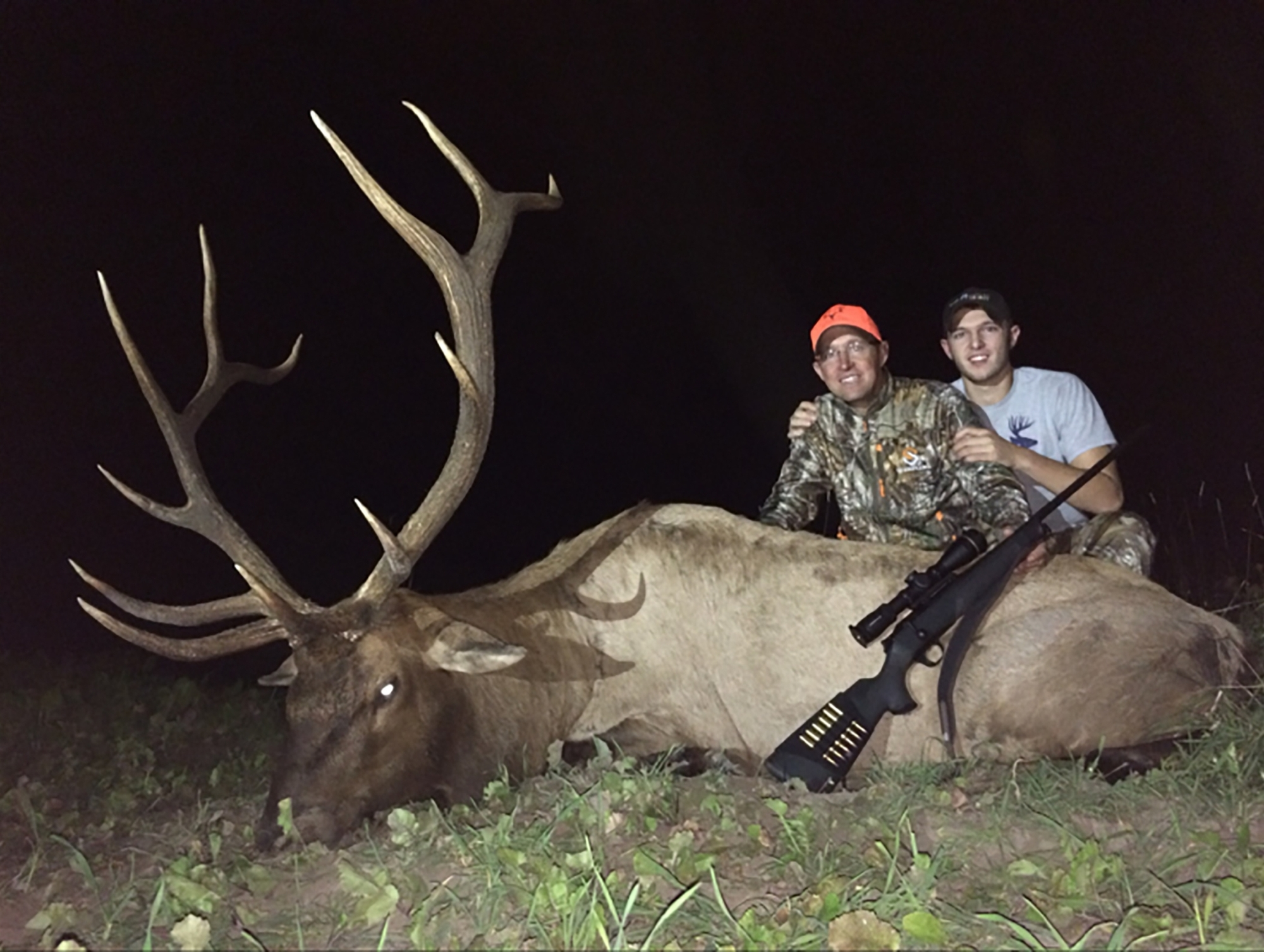 Pure Michigan Hunt 2015 winner Mike DiLorenzo of Rochester is shown with his son and the elk he bagged.