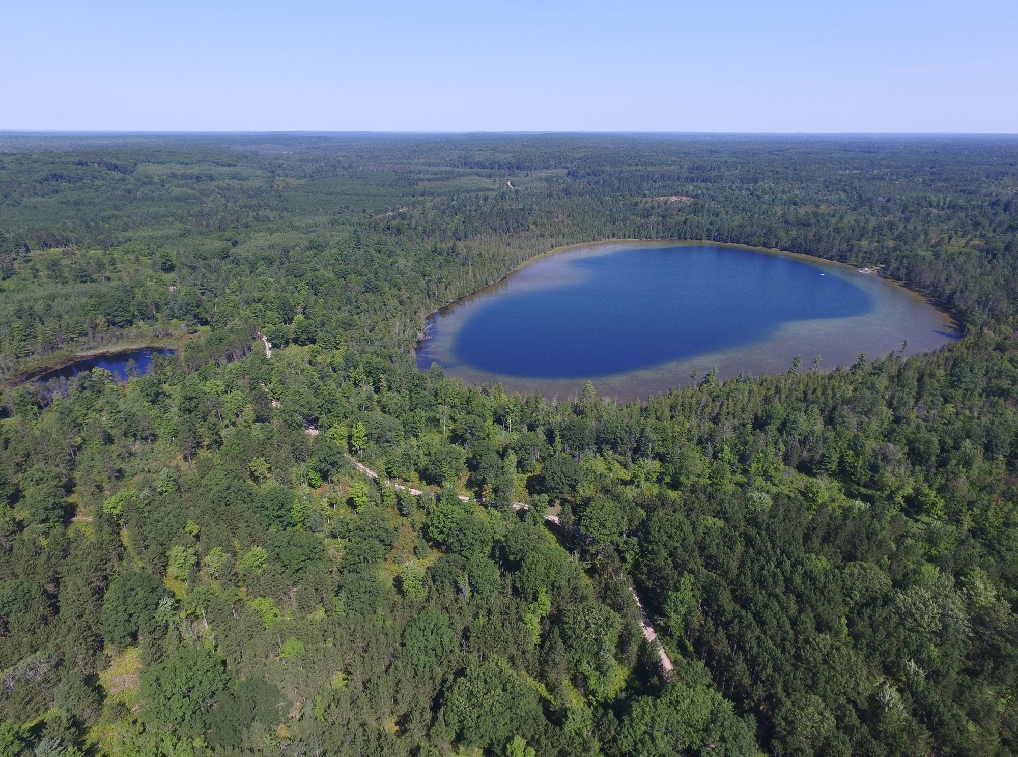 An aerial view of the Elk Forest at Black River project shows Walled Lake and a smaller pond located on the forested property.