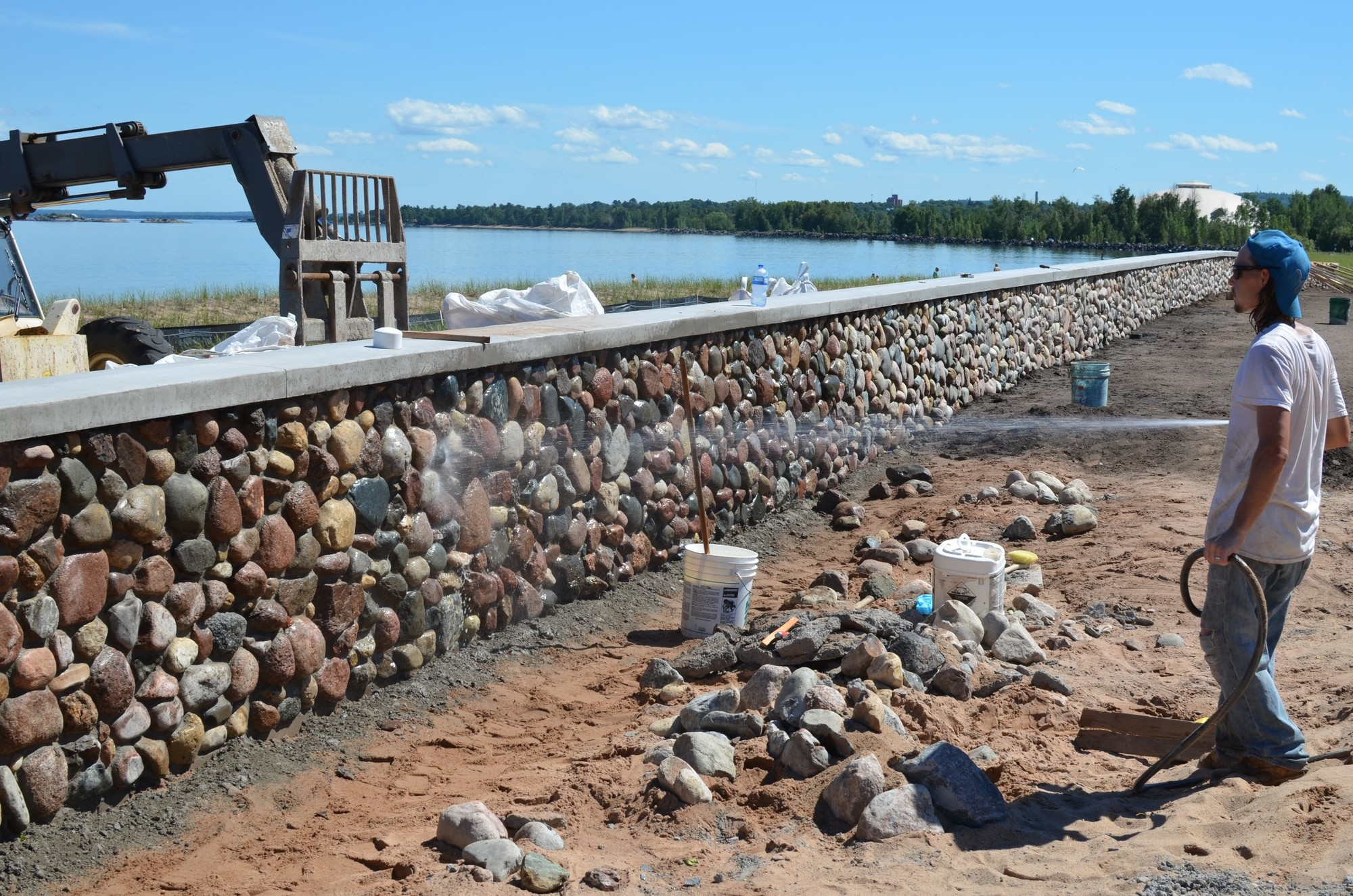 Workers building a decorative wall at Clark Lambros Beach Park in Marquette County this past summer.