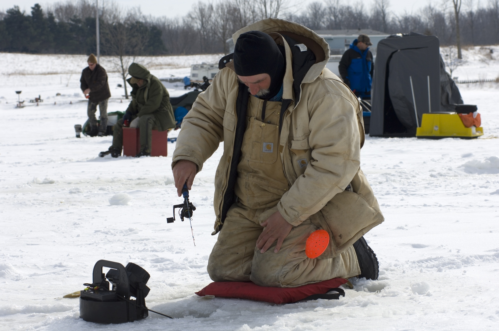 A group of anglers enjoying a day ice fishing in Michigan.