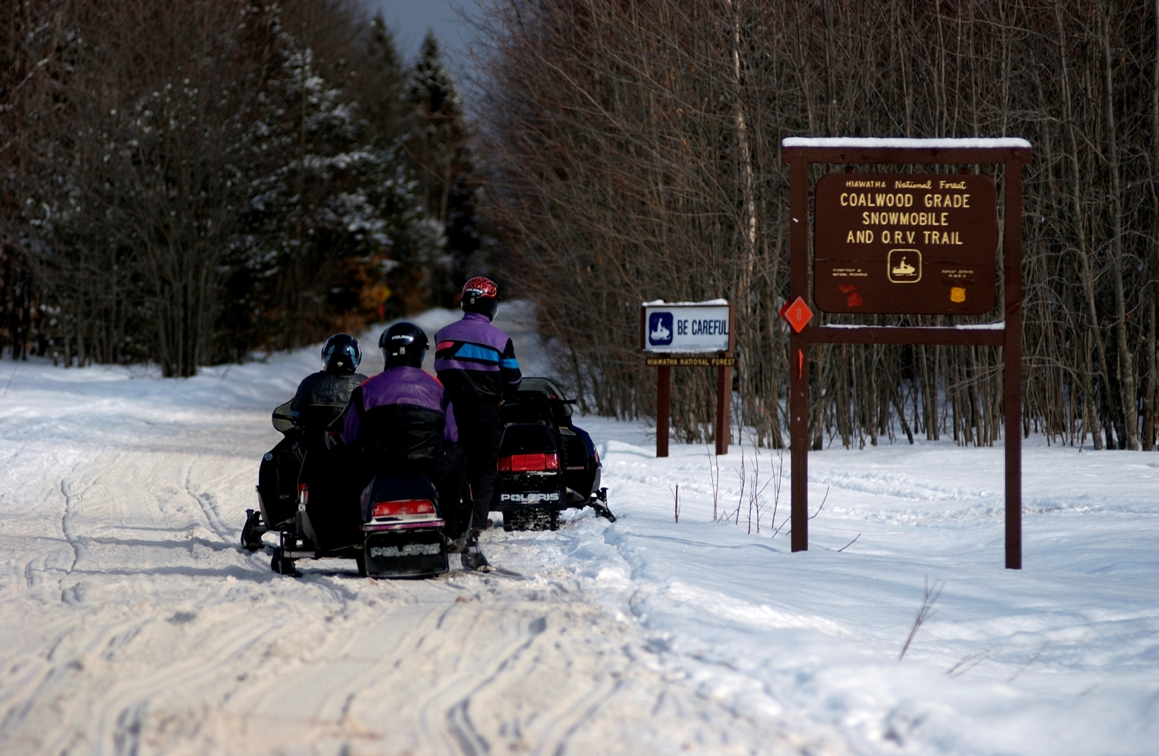 A group of snowmobilers gets ready to explore the Coalwood Grade Snowmobile and ORV Trail in the central Upper Peninsula.
