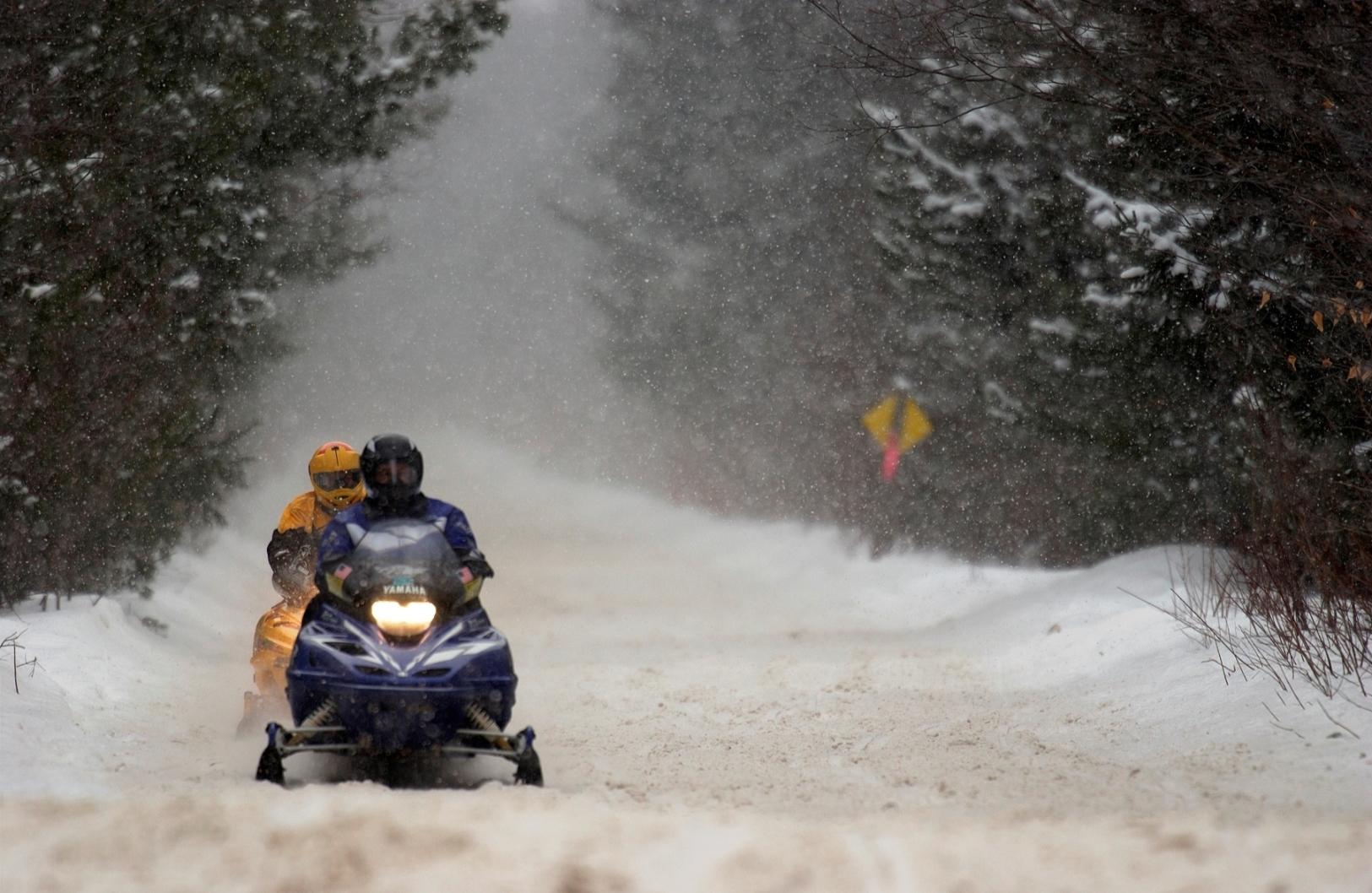 A couple of riders get a chance to enjoy a Michigan snowmobile ride.