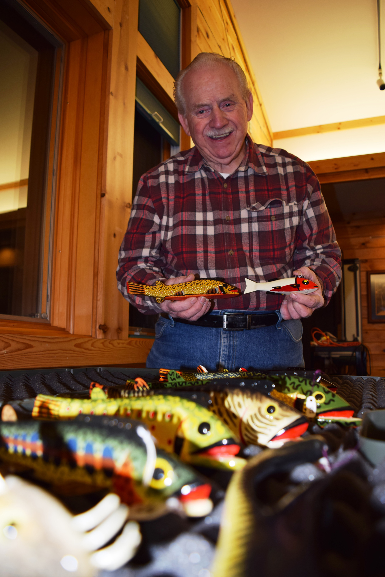 Al Nelson shows off some of the fish decoys he carved.