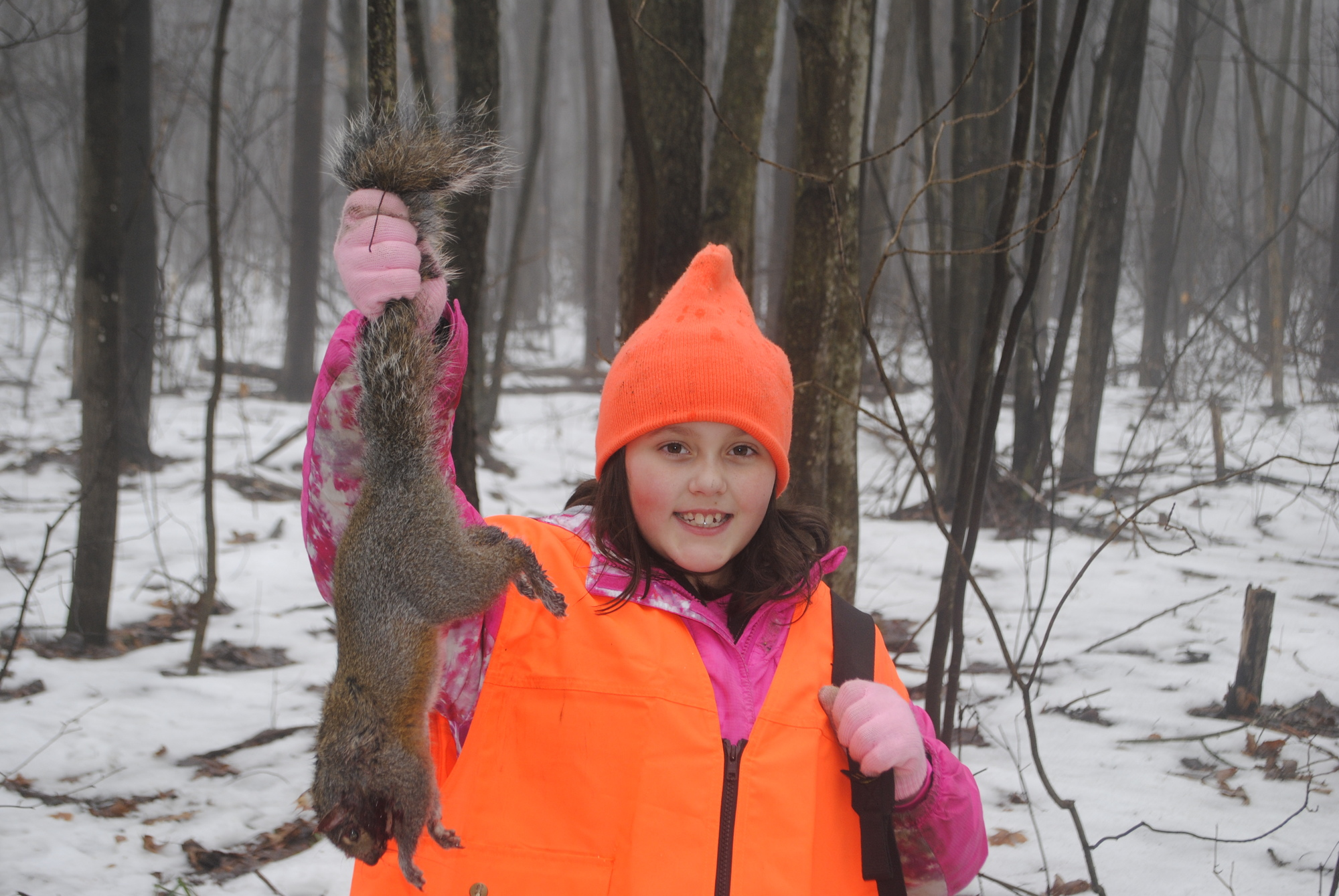 Destiny Ery, 10, shows off a squirrel she took at the Flat River State Game Area near Belding, which is located northeast of Grand Rapids.