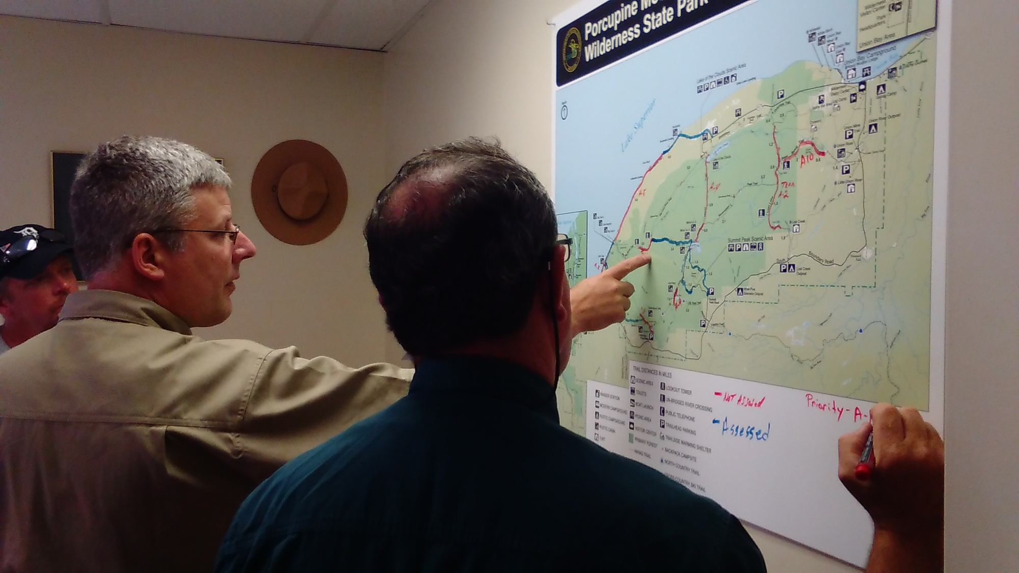 Members of the incident command team look over a progress map at Porcupine Mountains Wilderness State Park.