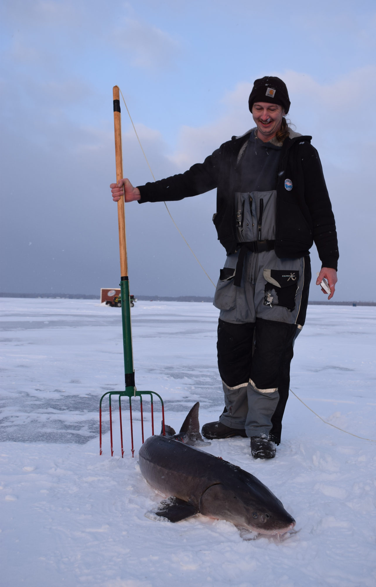 Rick Taylor shows off the sturgeon he speared at Black Lake.