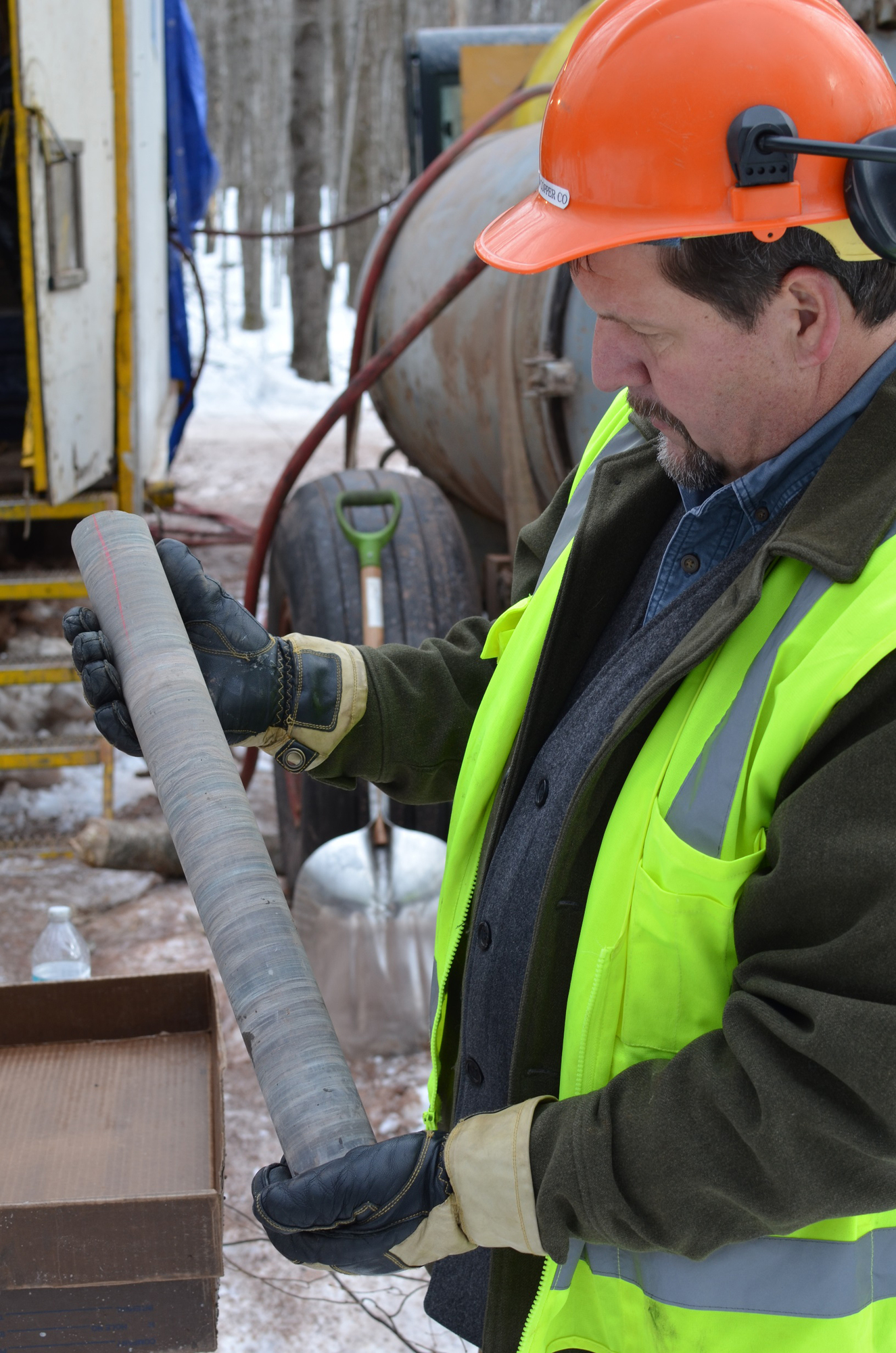Dave Anderson, Highland Copper's director of environment, stakeholder relations and Michigan corporate affairs, holds a core sample.