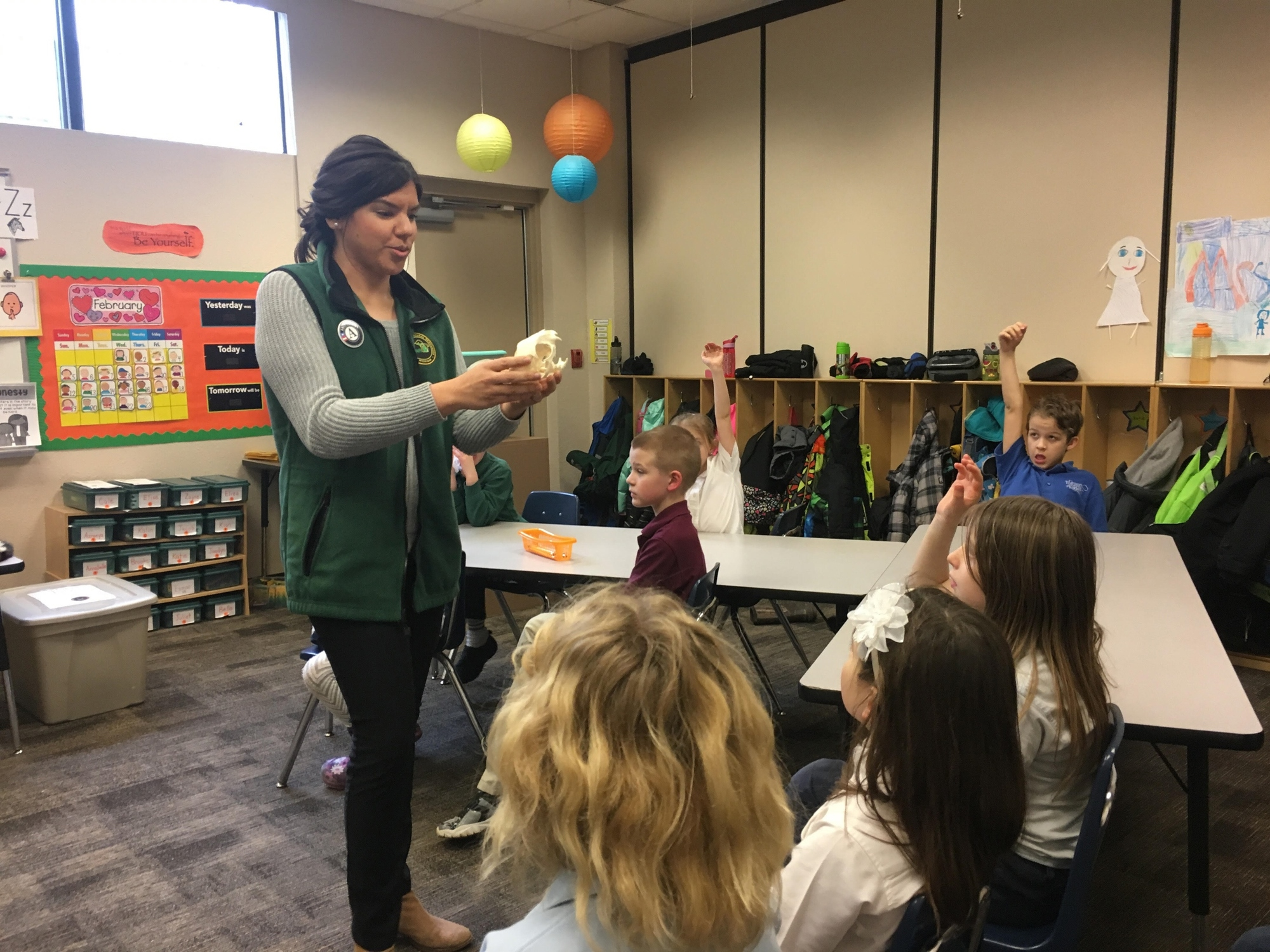 Huron Pines AmeriCorps member Kimberlyn Burgos teaches a class of first graders about Michigan wildlife.
