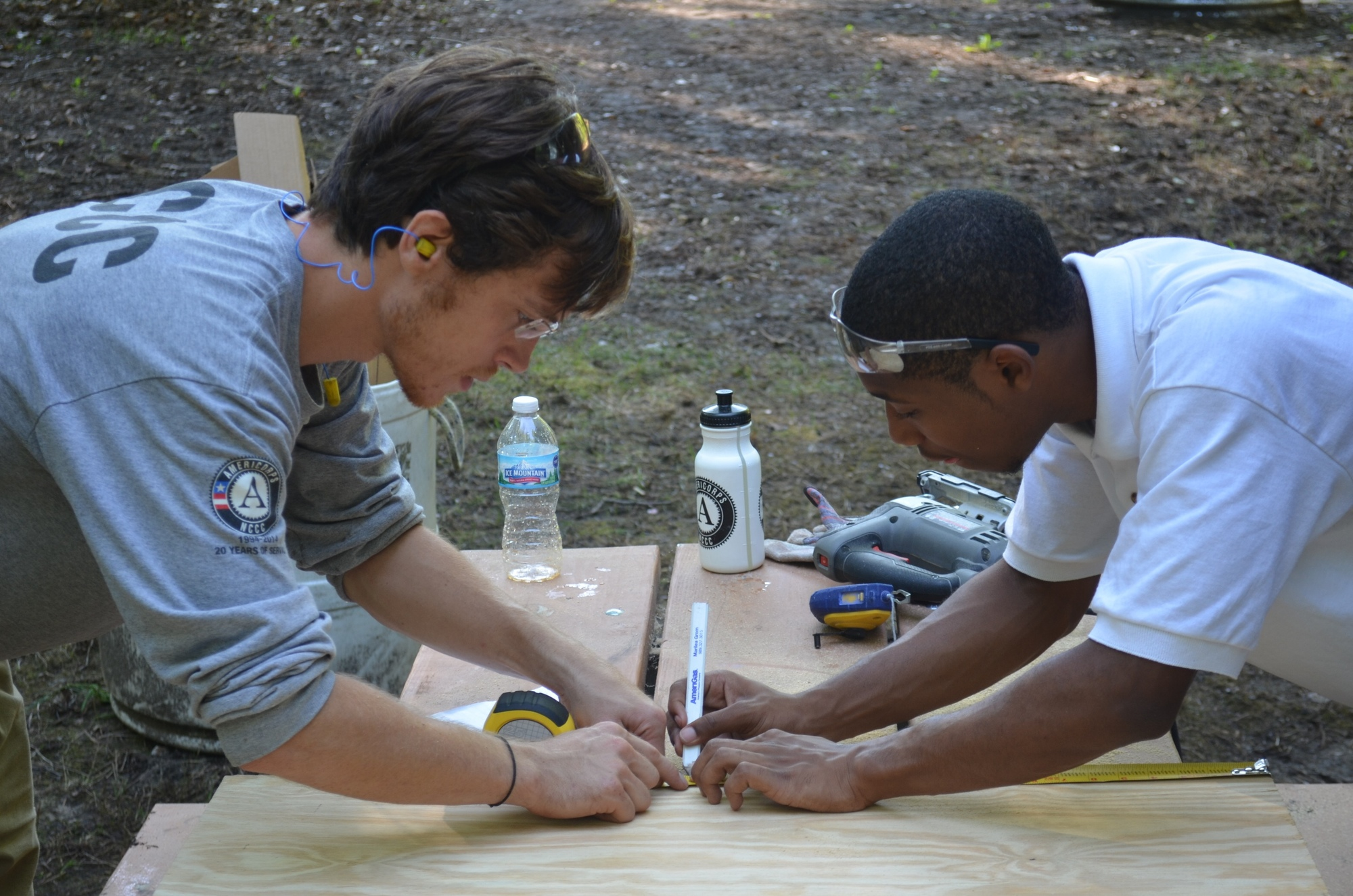 AmeriCorps NCCC members worked with Summer Youth Employment Program participants at Waterloo State Recreation Area to refurbish cabins near Mill Lake.