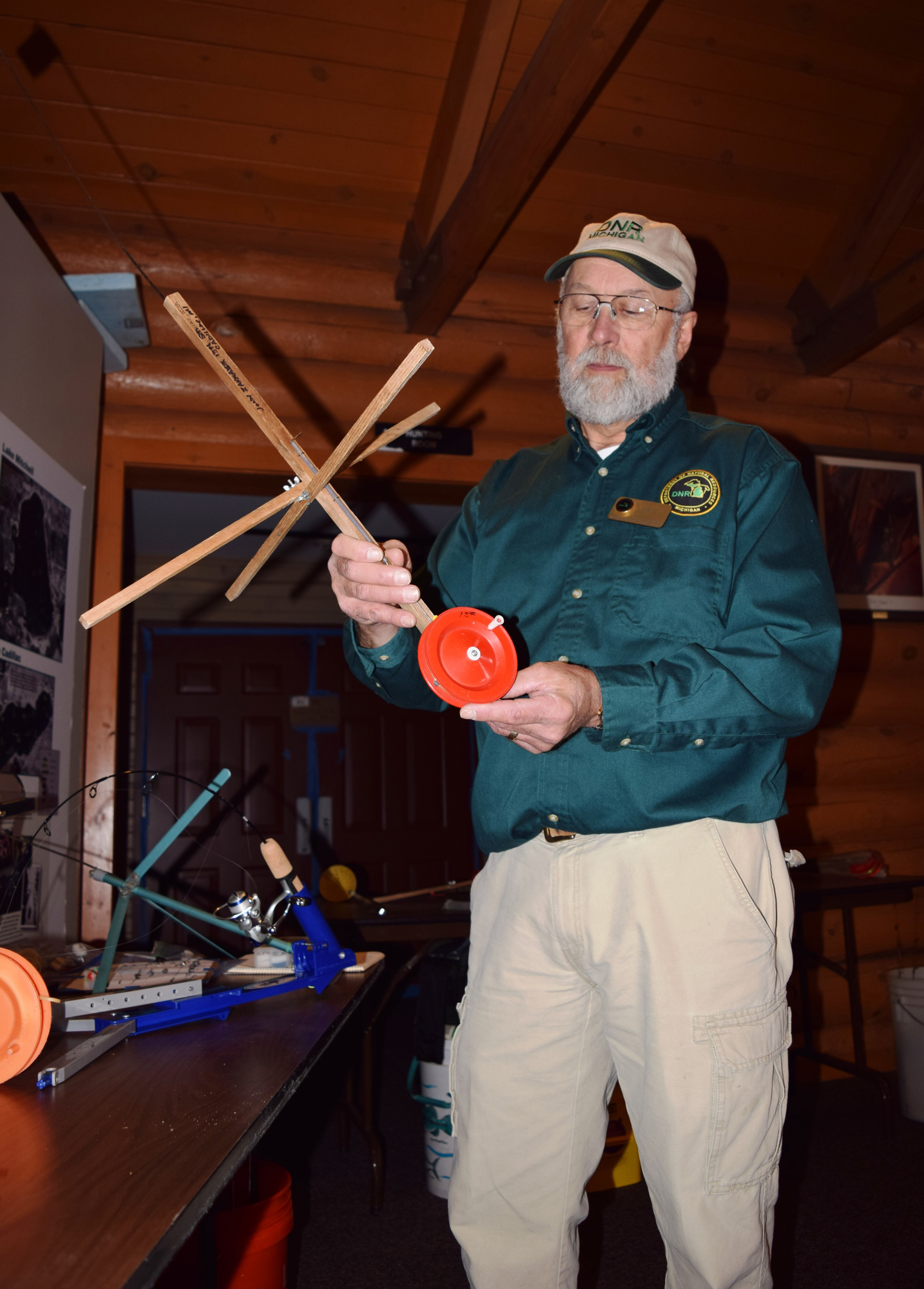 John Zakrajsek, a seasonal interpreter at the Carl T. Johnson Hunt and Fish Center, presents a seminar on tip-ups.