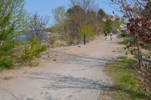 Biker and jogger on trail along Lake Superior shoreline