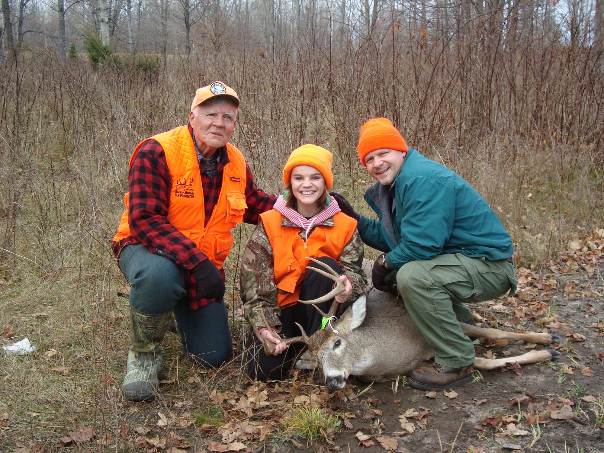 Scott Whitcomb, right, his father, Doug and his daughter, Mikayla pose for a photo with Mikayla's first buck.