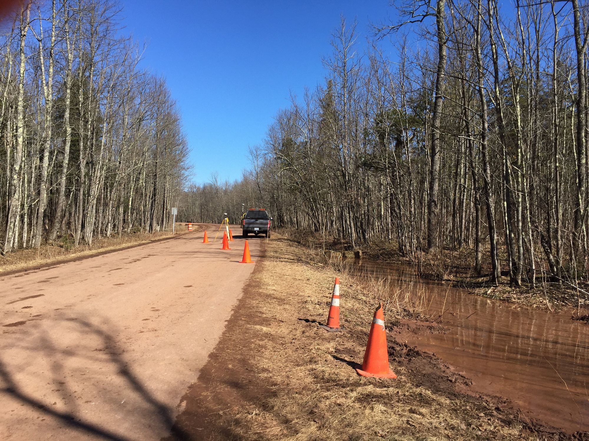 Water is shown in a ditch between a snowmobile trail and the east edge of Gogebic County Road 519. Erosion control measures are in place.