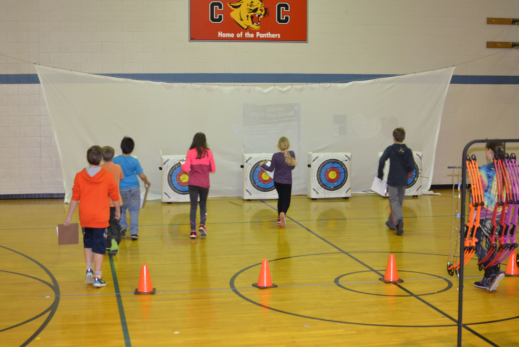 Cherry Creek Elementary School archers approach their targets, eager to check their scores.