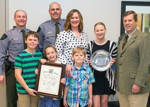 DNR officer Steve Converse, second from left, with his family and others accepting an award