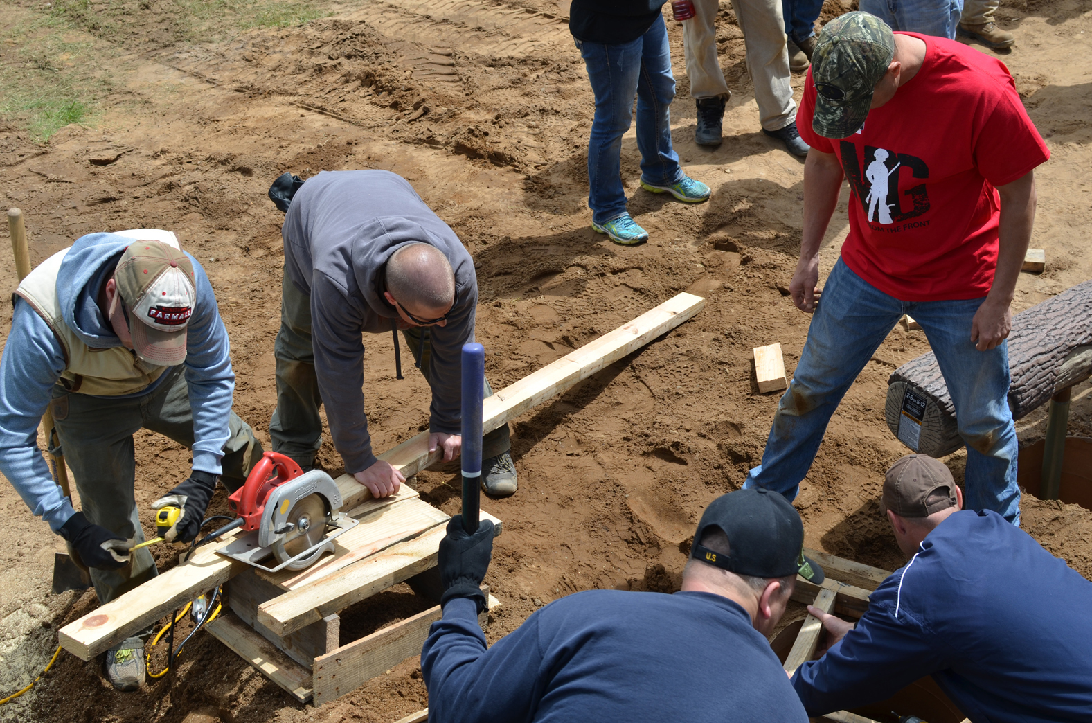 Volunteers work on the playground project at Van Riper State Park in Marquette County.