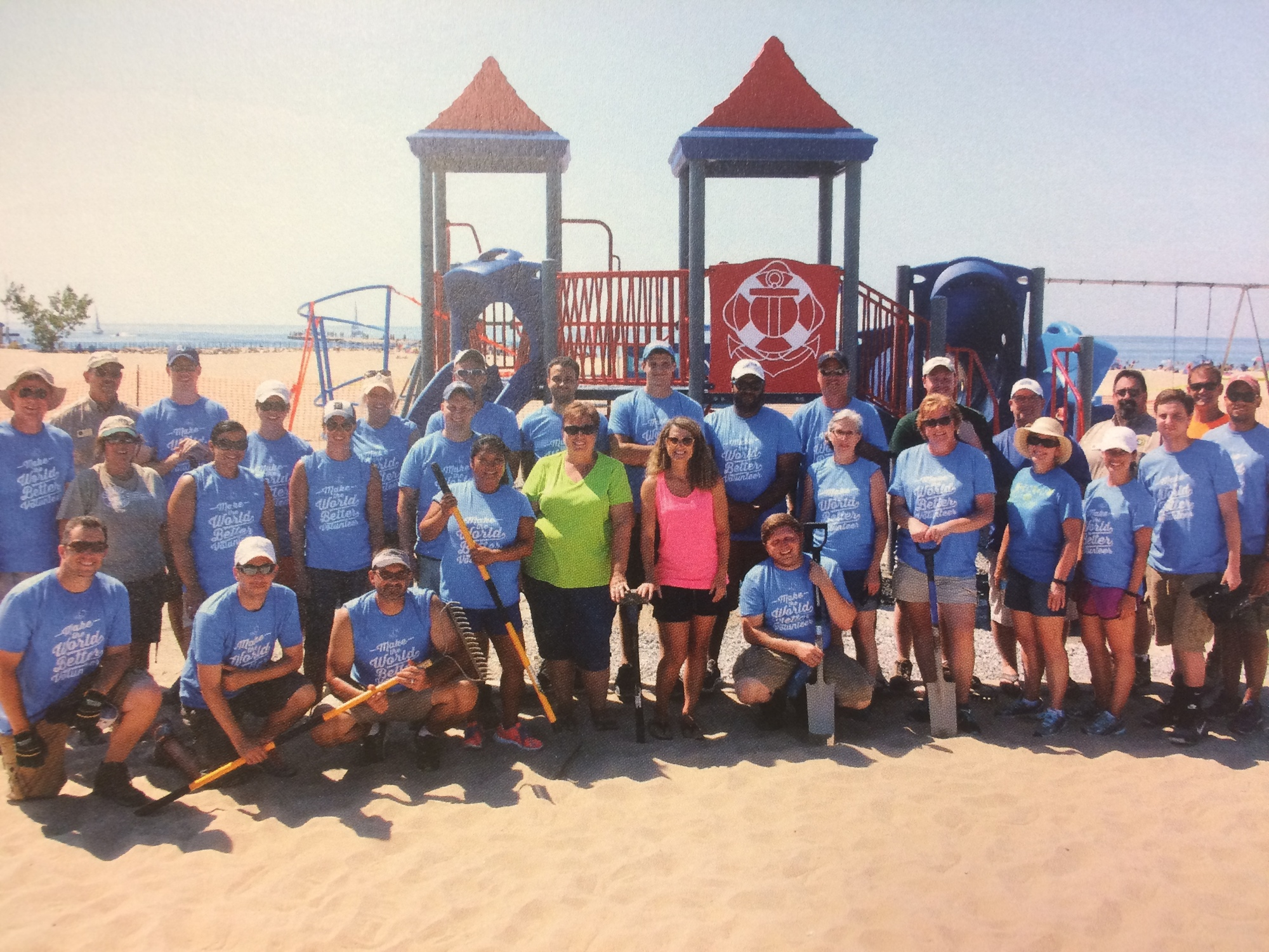 Sally Starr (center left) and Nancy VanEenenaam (center right), were the catalysts for a new playground at Holland State Park.