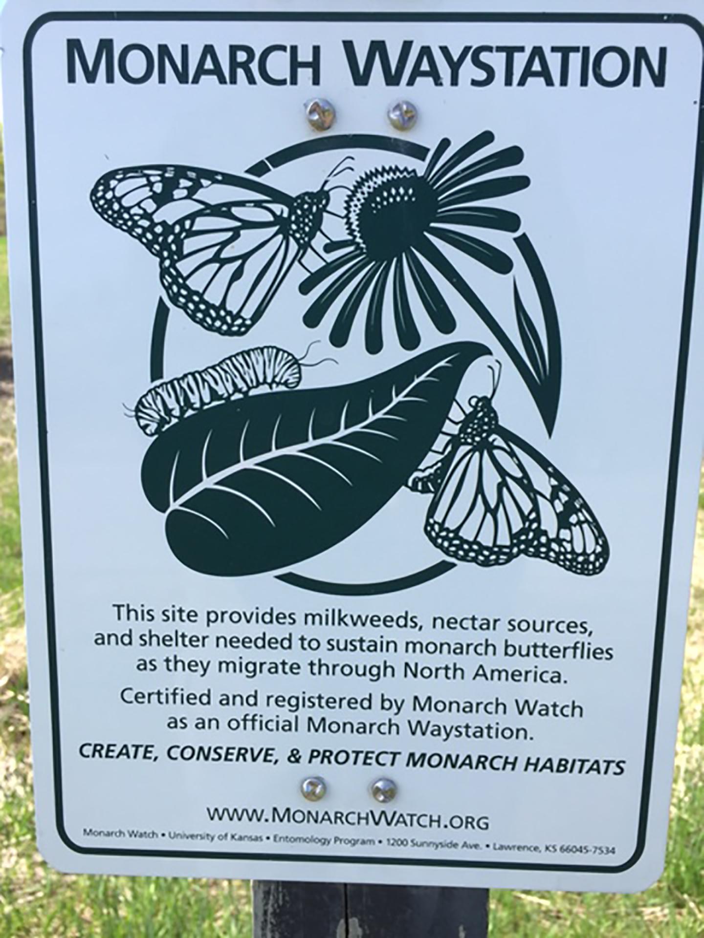 A sign marks a Monarch Waystation.
