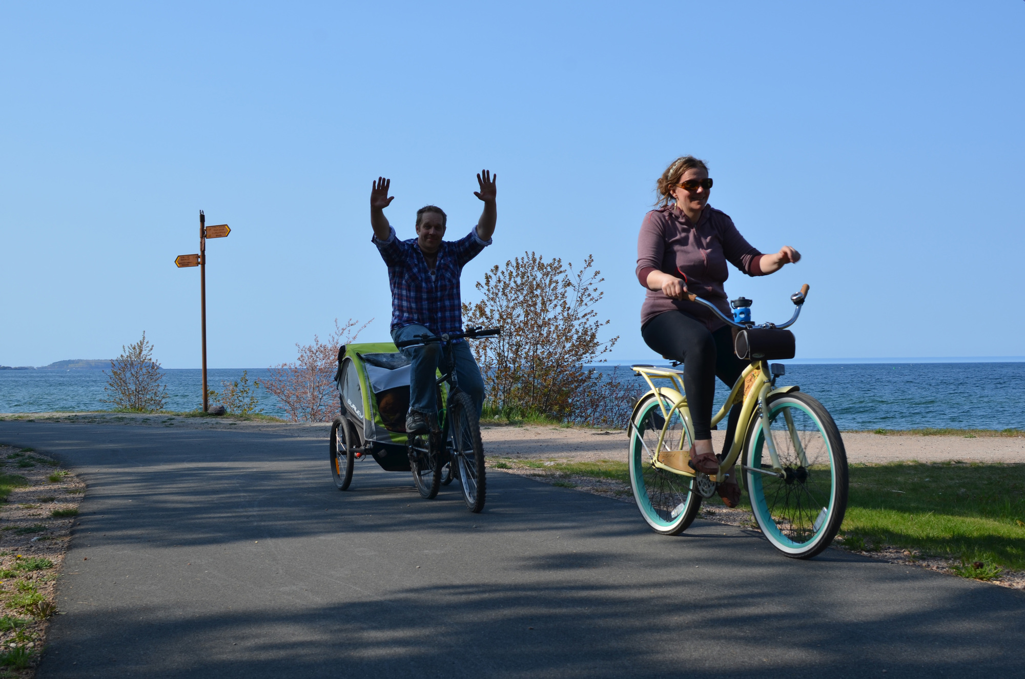 Bikers enjoy a stretch of the Iron Ore Heritage Trail, along Lake Superior, in Marquette County.