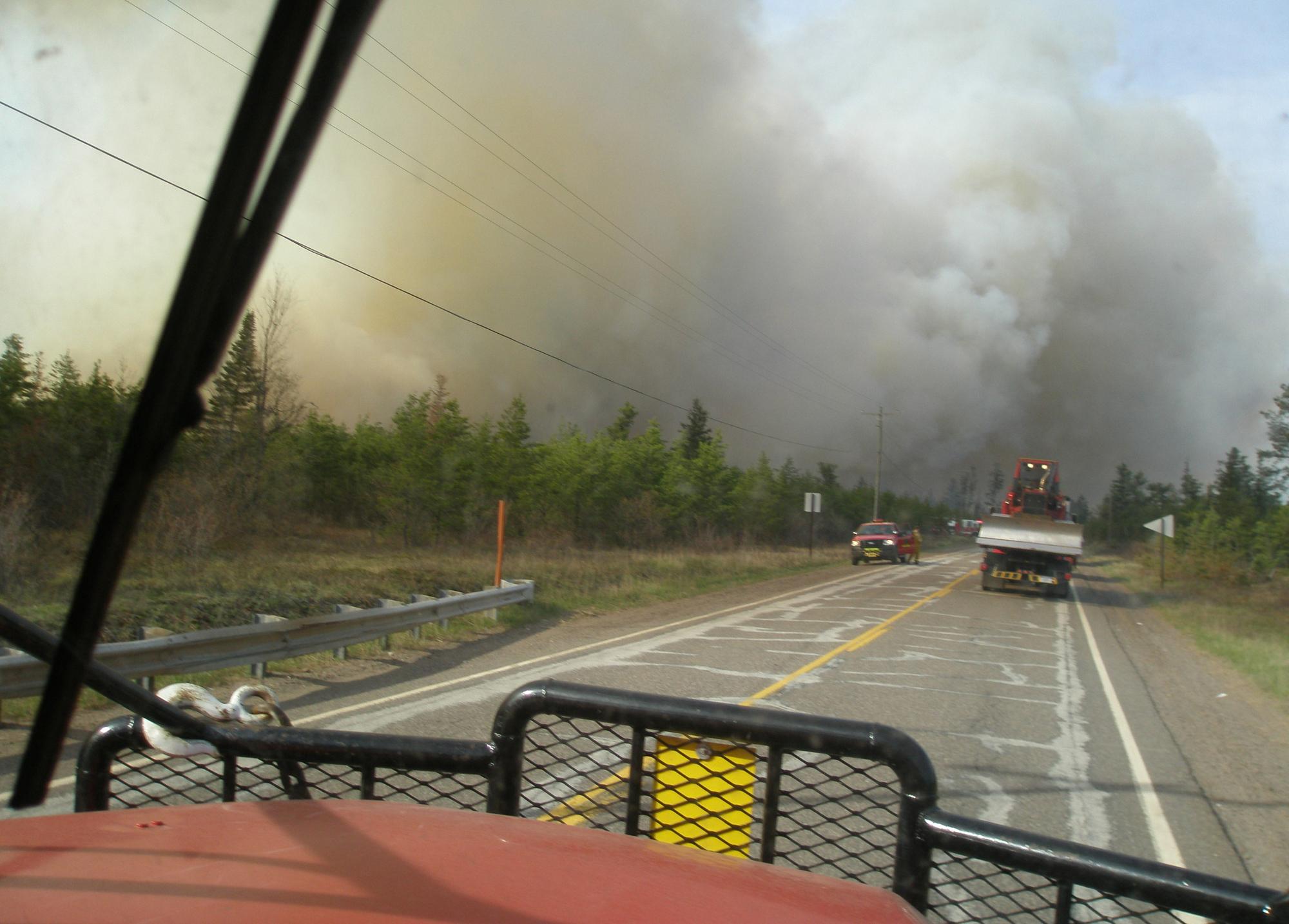 A fire crew heads down Marquette County Road 581 toward the Black River Falls Fire.