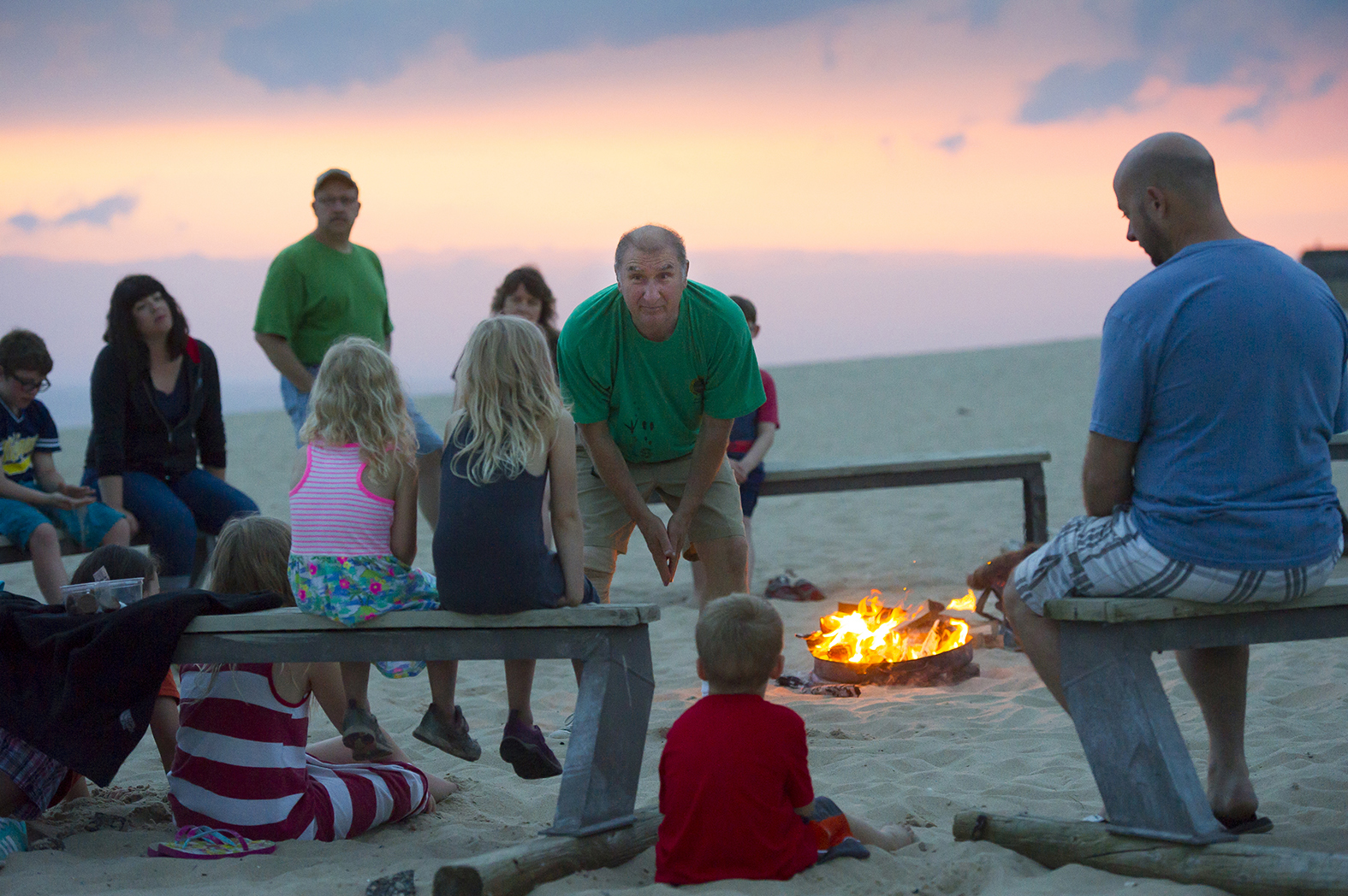 Mike Latus, State Park Explorer Program guide at Warren Dunes State Park, talks with some young park visitors.
