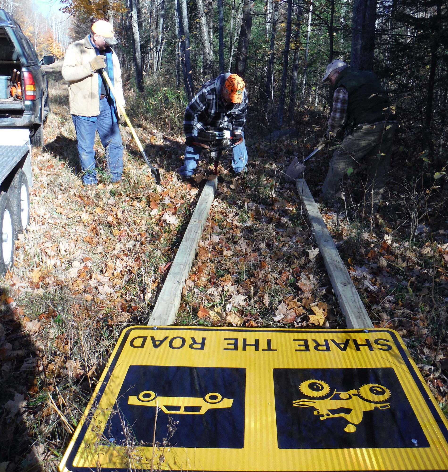 A crew gets ready to put a sign up along a Michigan Trails and Recreation Alliance of Land and the Environment (MI-TRALE) project in the western U.P.