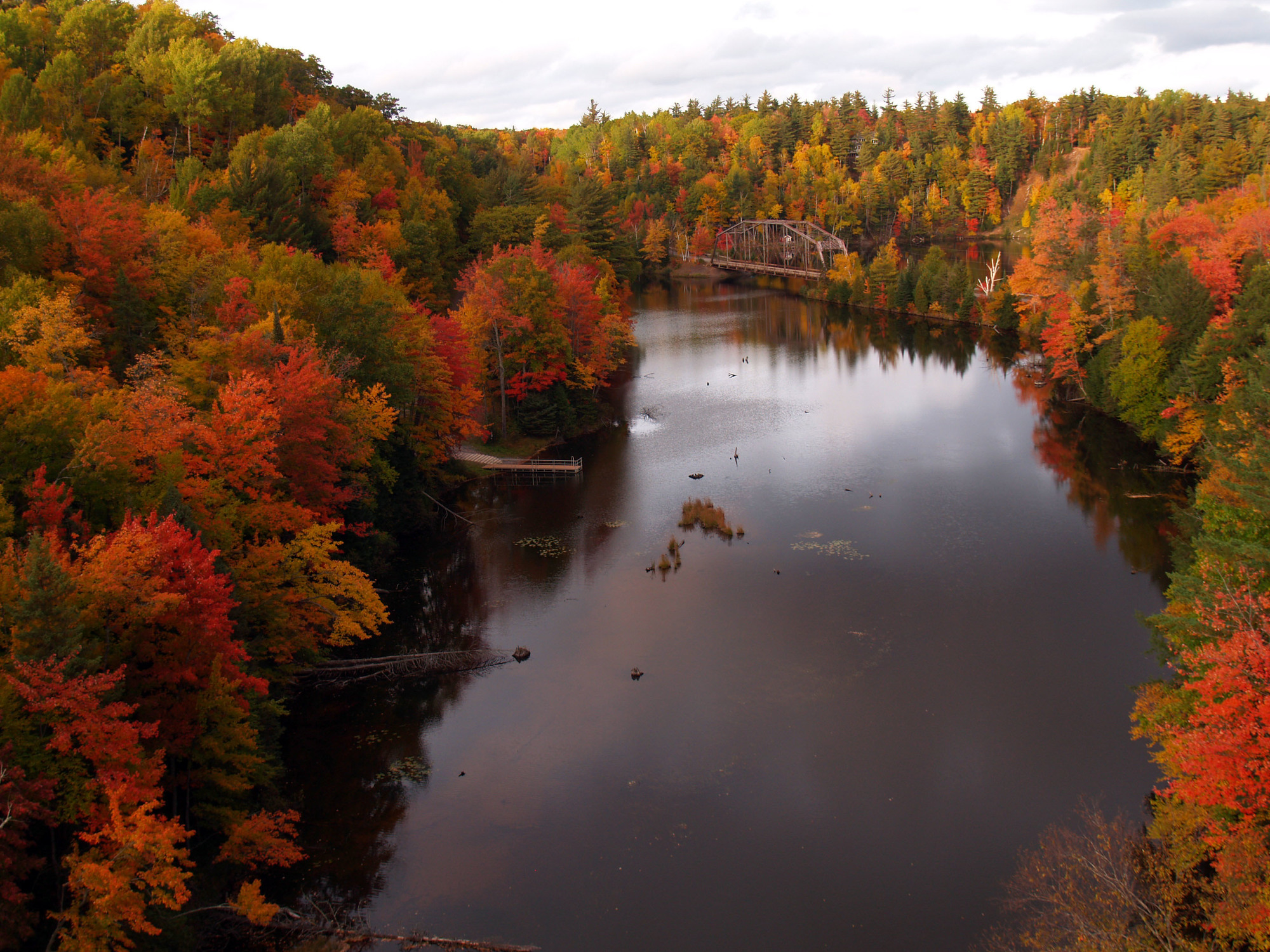 A beautiful fall color view of the Dead River in Marquette County from a bridge popular with fall leaf peepers.